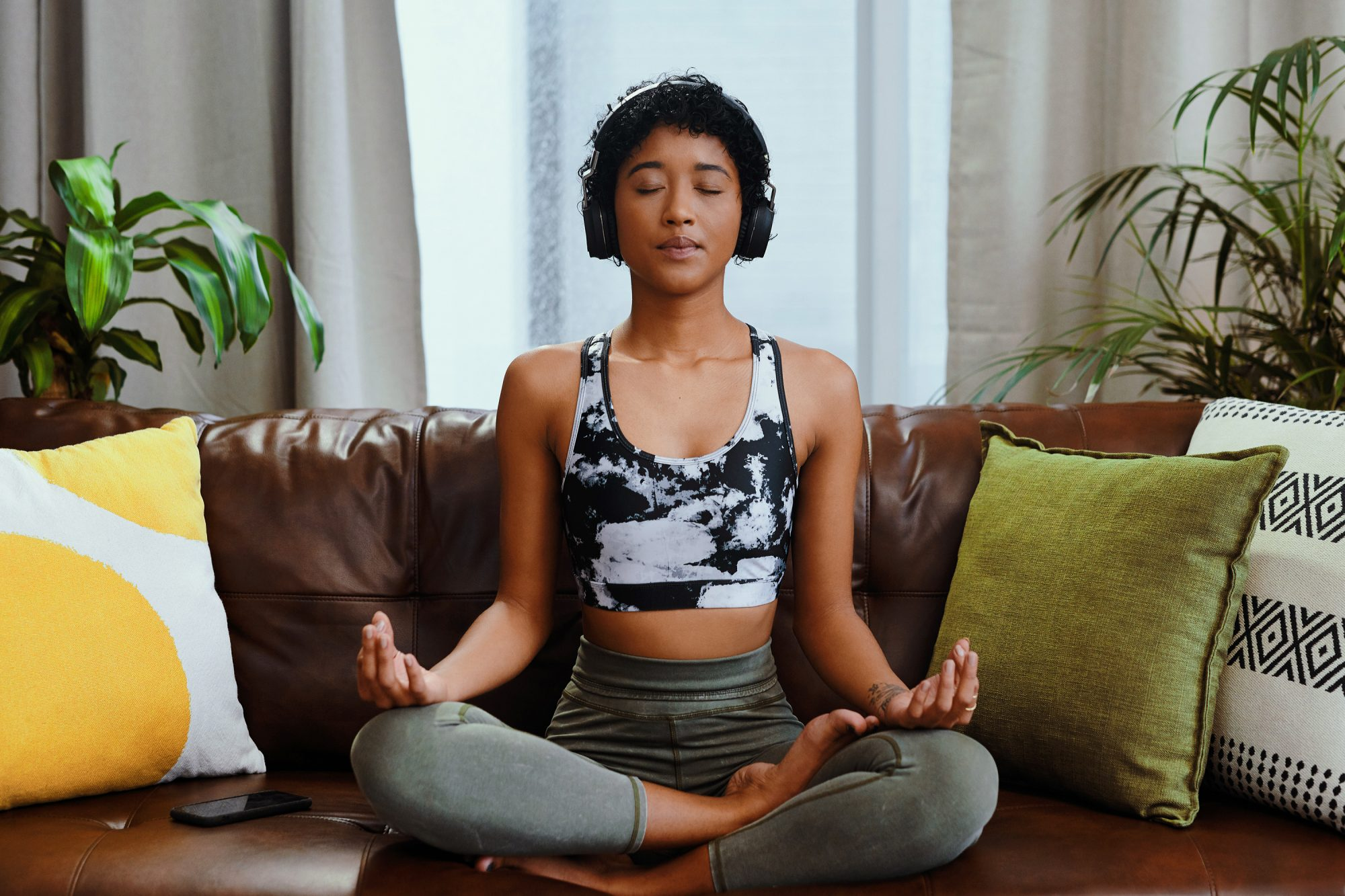 The best free meditation apps: woman meditating at home