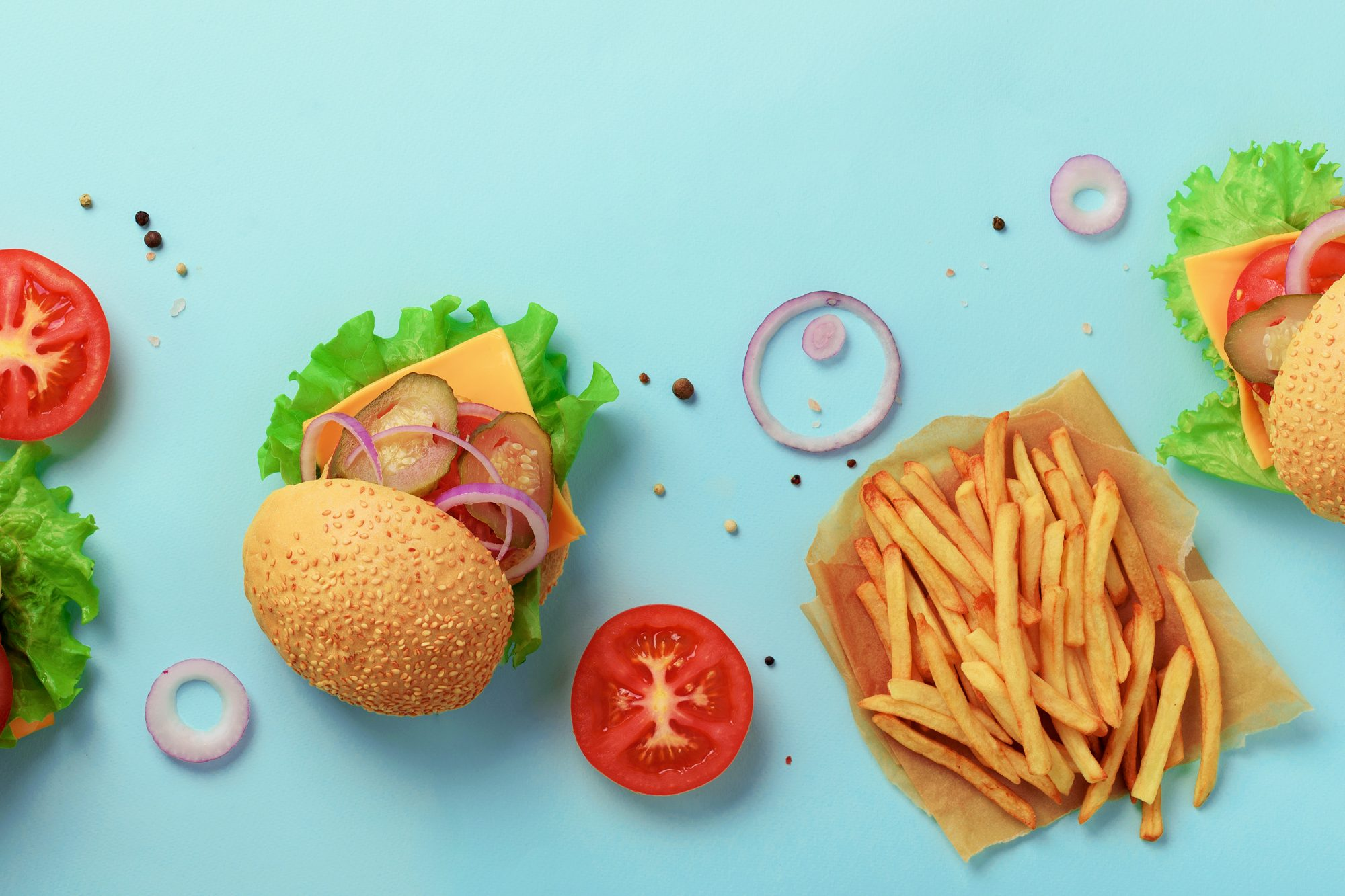 Healthy Fast Food Orders According to RDs: image of cheeseburger, fries, tomato, lettuce, onion