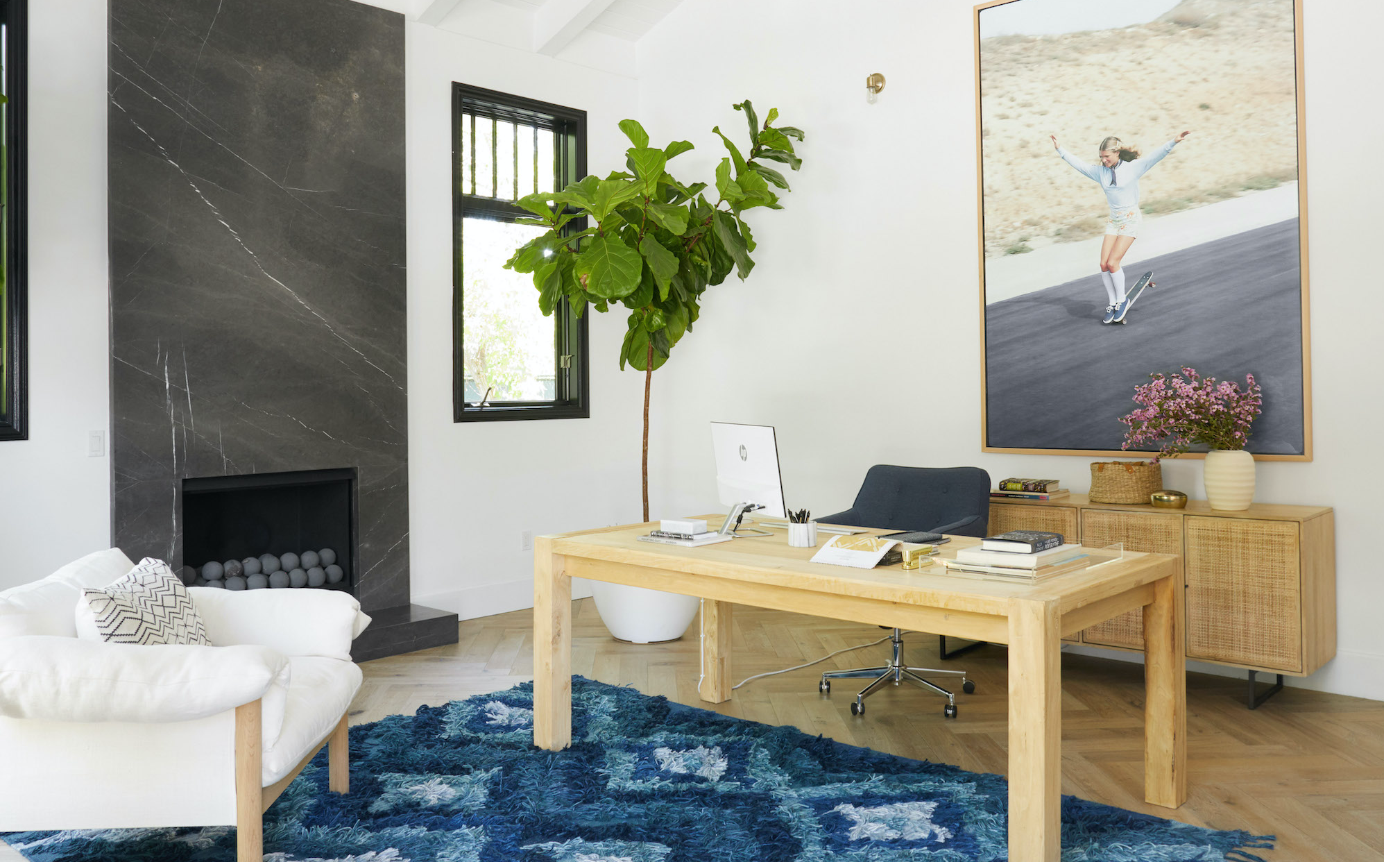 Home office with wooden desk and large art