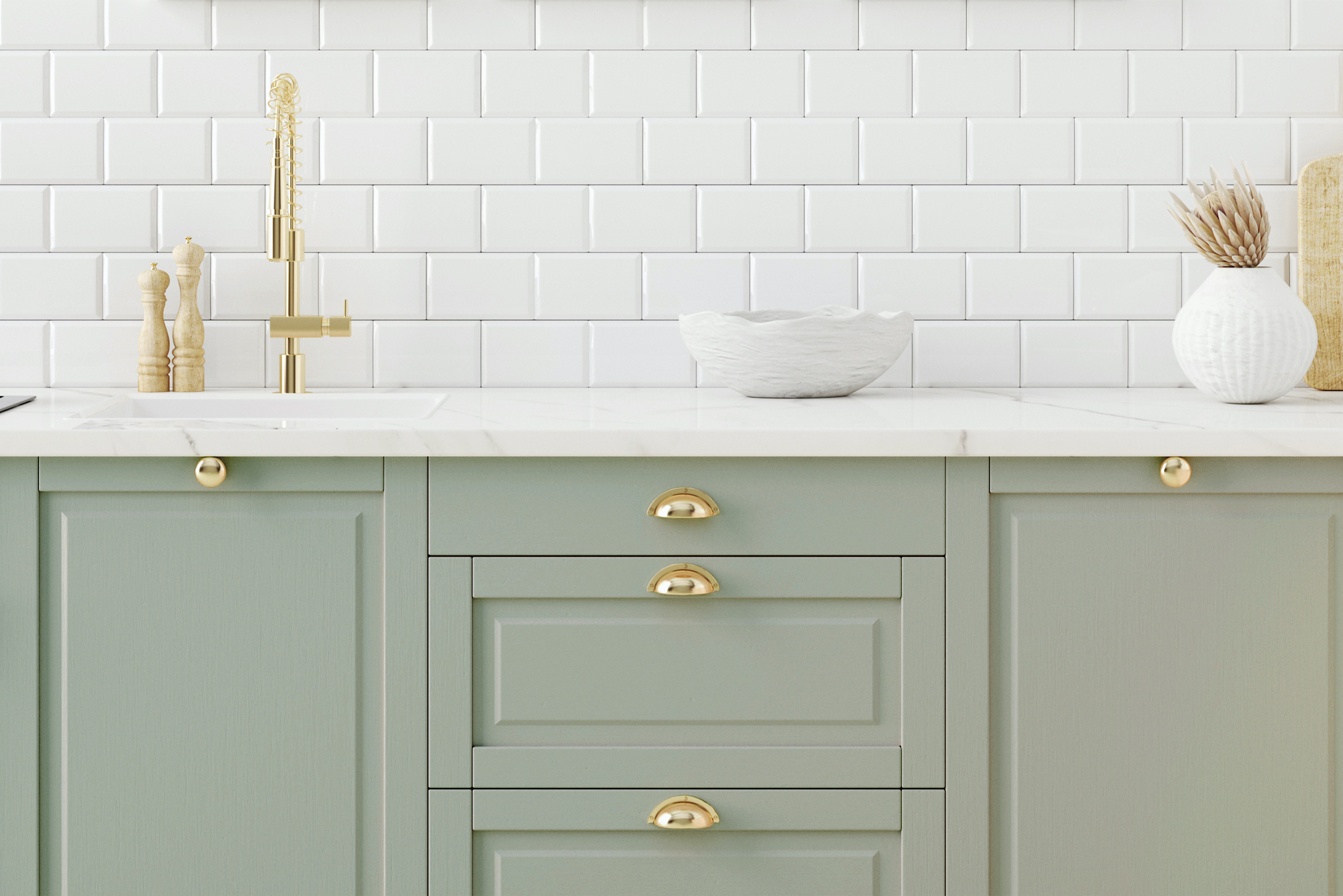 Kitchen with green cabinets and gold hardware