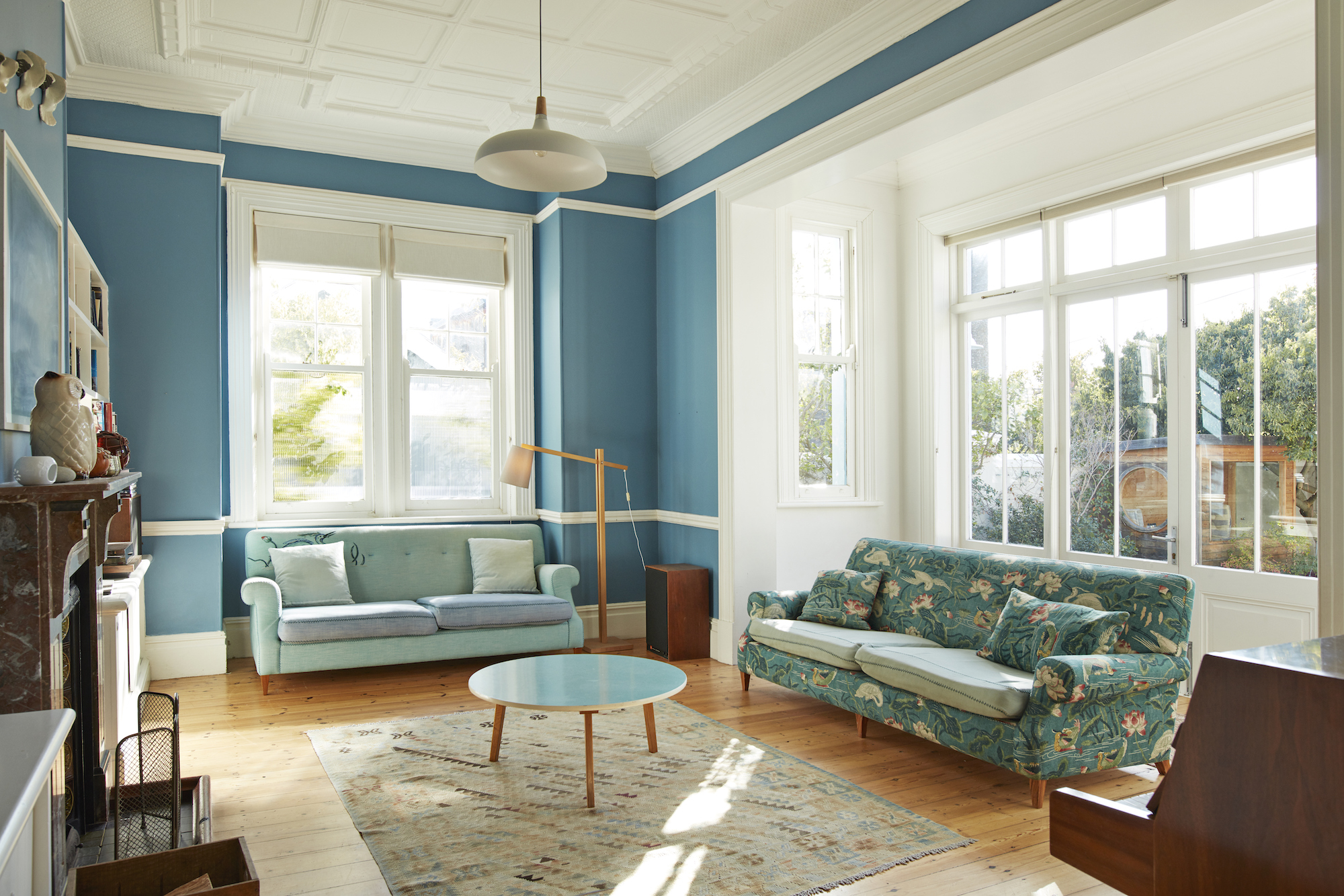 Blue Walls and White Trim in Living Room