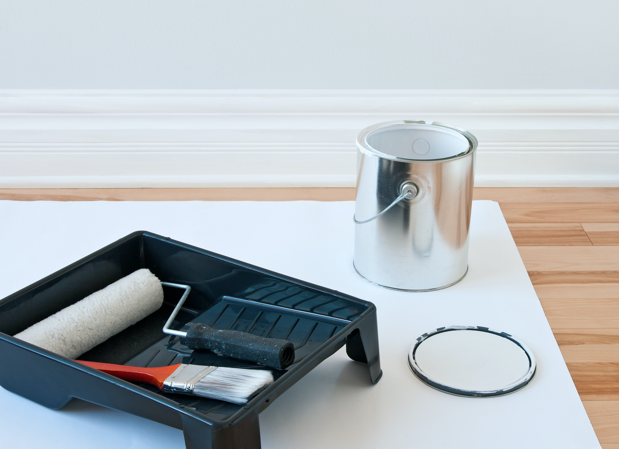 paint can and roller in tray