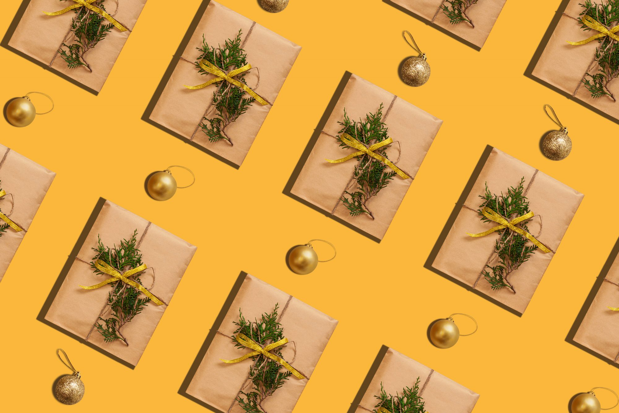 Trendy Christmas pattern made with paper gift boxes photo on pastel background. Minimal zero waste New Year concept.