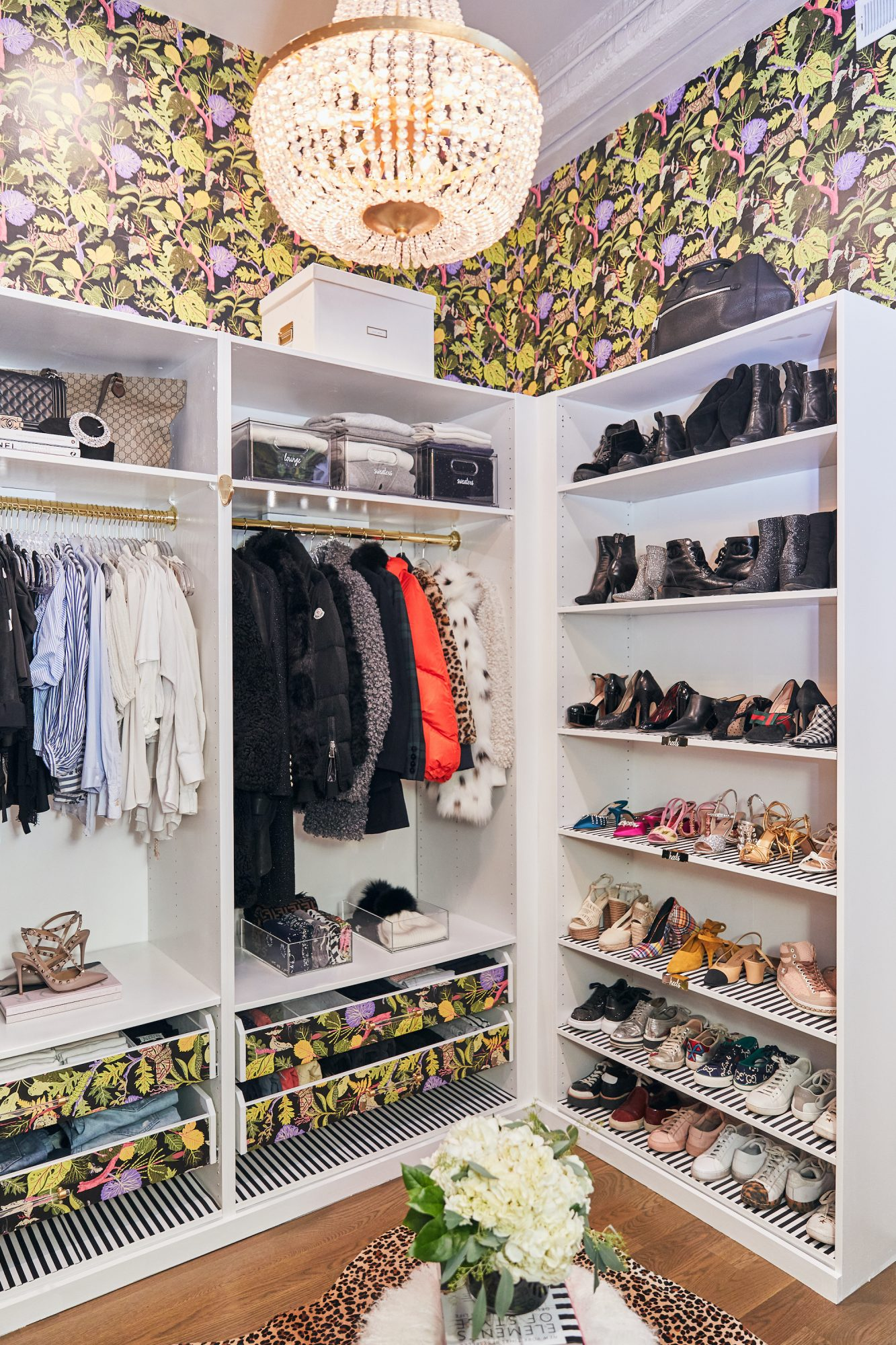 closet with floral wallpaper