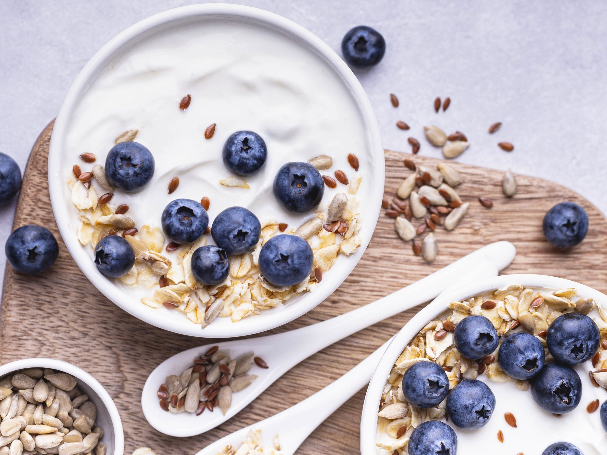 Close up of a bowl with natural yogurt and some fresh blueberries