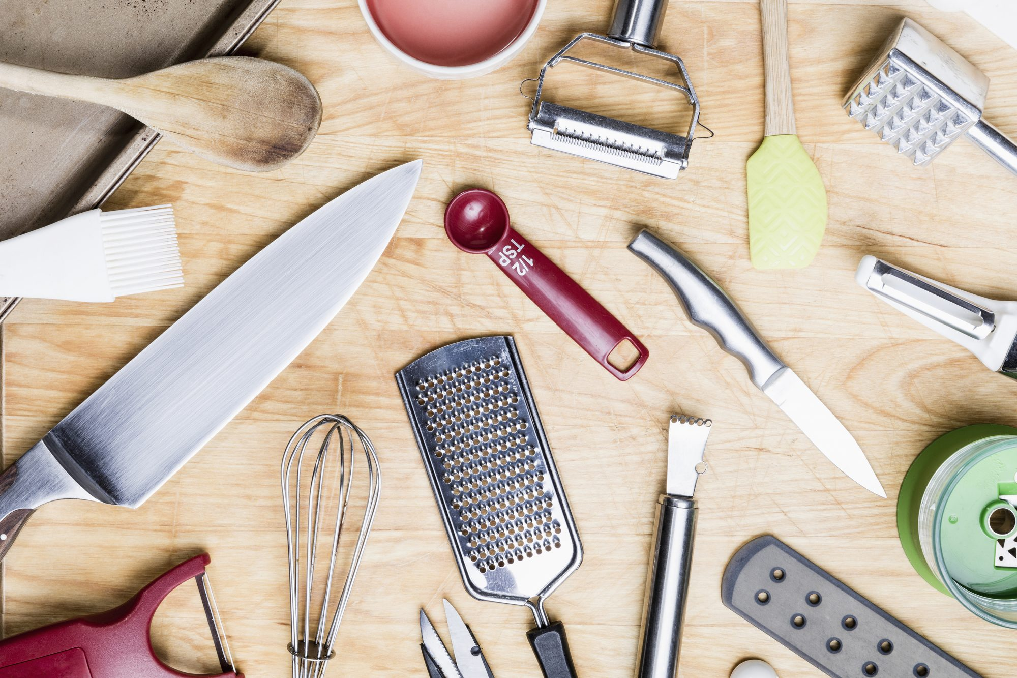 View from above kitchen utensils on wooden surface - knolling