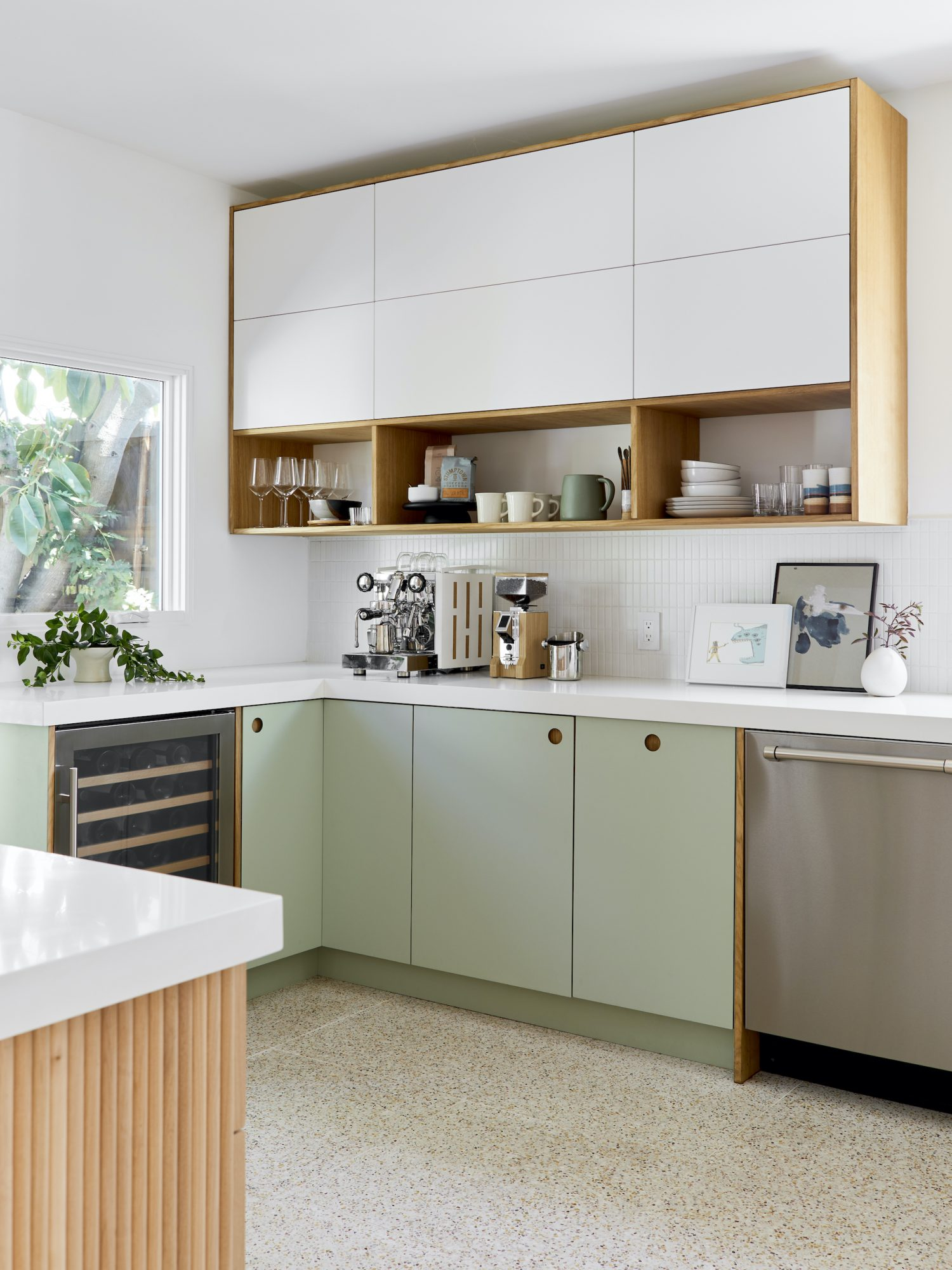 Clean design kitchen with green lower cabinets and white uppers