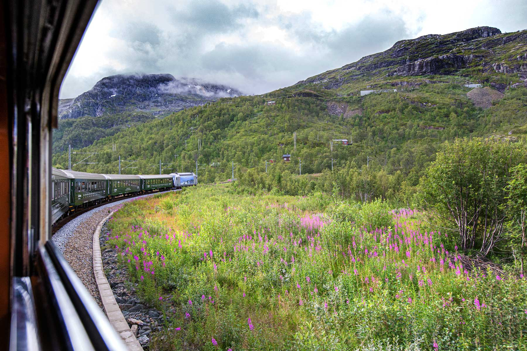 Spectacular view from the famous Norwegian Flåm train speeding uphill on its way to Myrdal station. Said to be one of the most beautiful railway journeys on the planet.