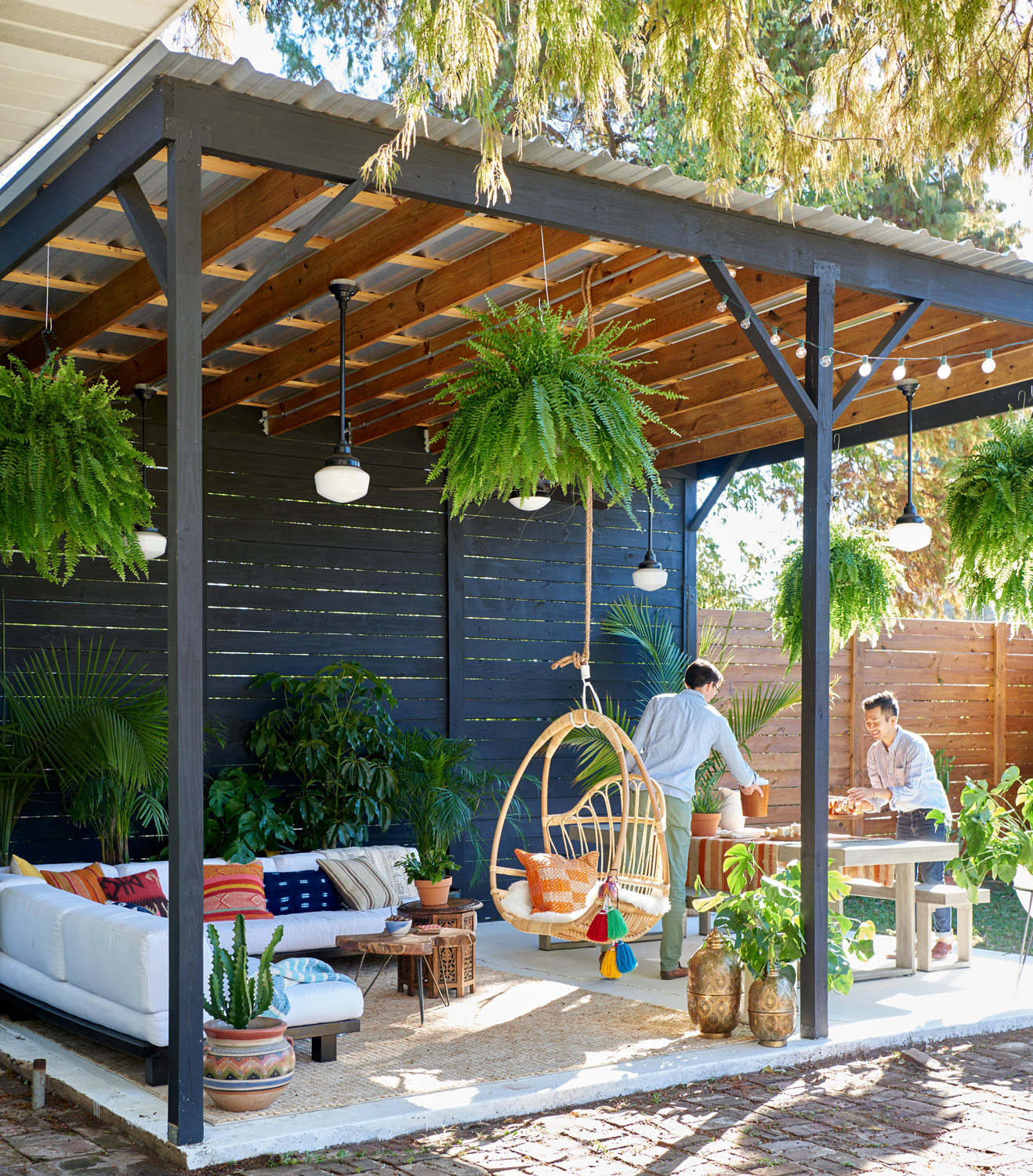 outdoor living space with sectional and porch swing