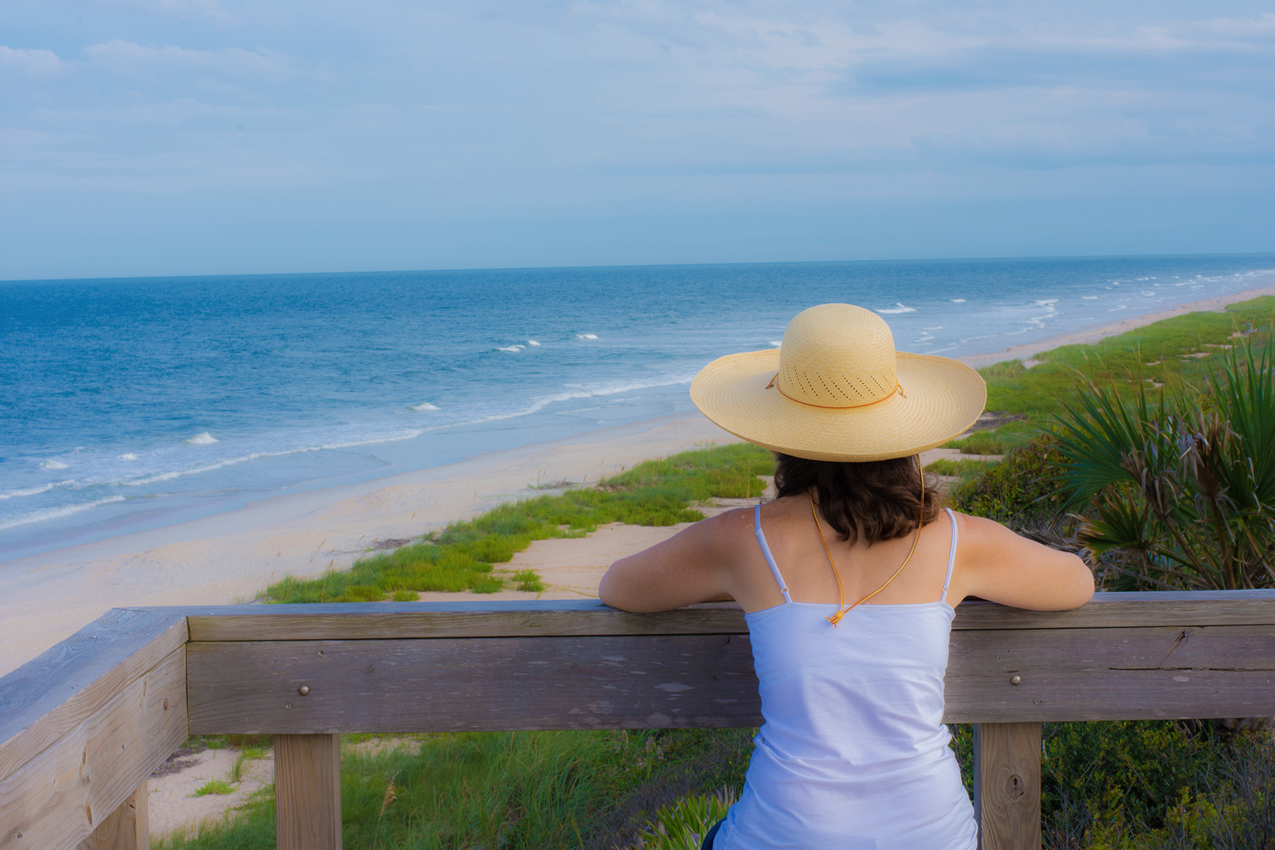 A woman Florida watches the beach of St. Augustine, Florida.