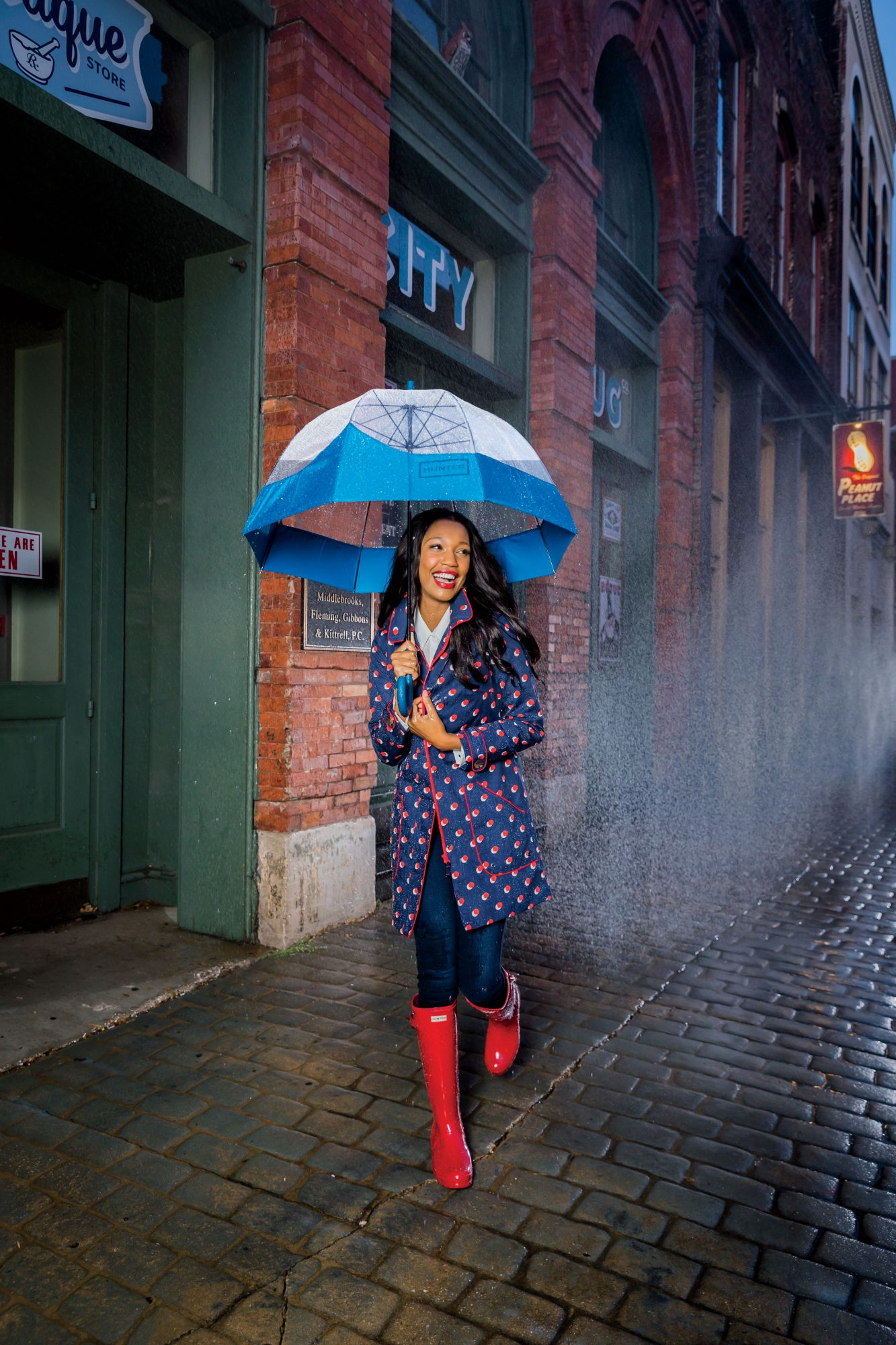 Boden Trench Coat in Navy with Red Polka Dots in the Rain