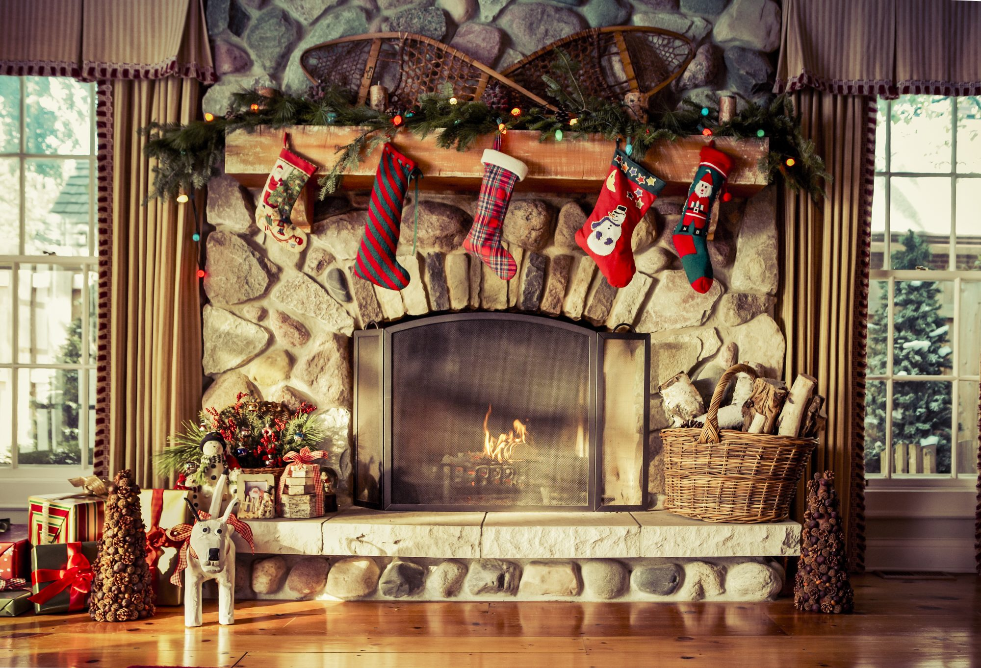 Christmas Stockings Hanging on Stone Fireplace