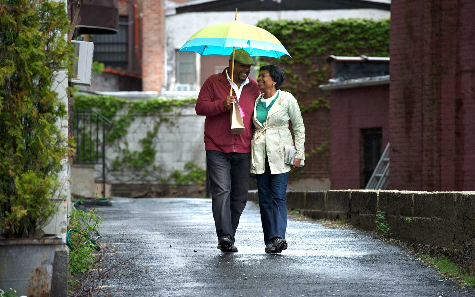 Couple walking and smiling together.