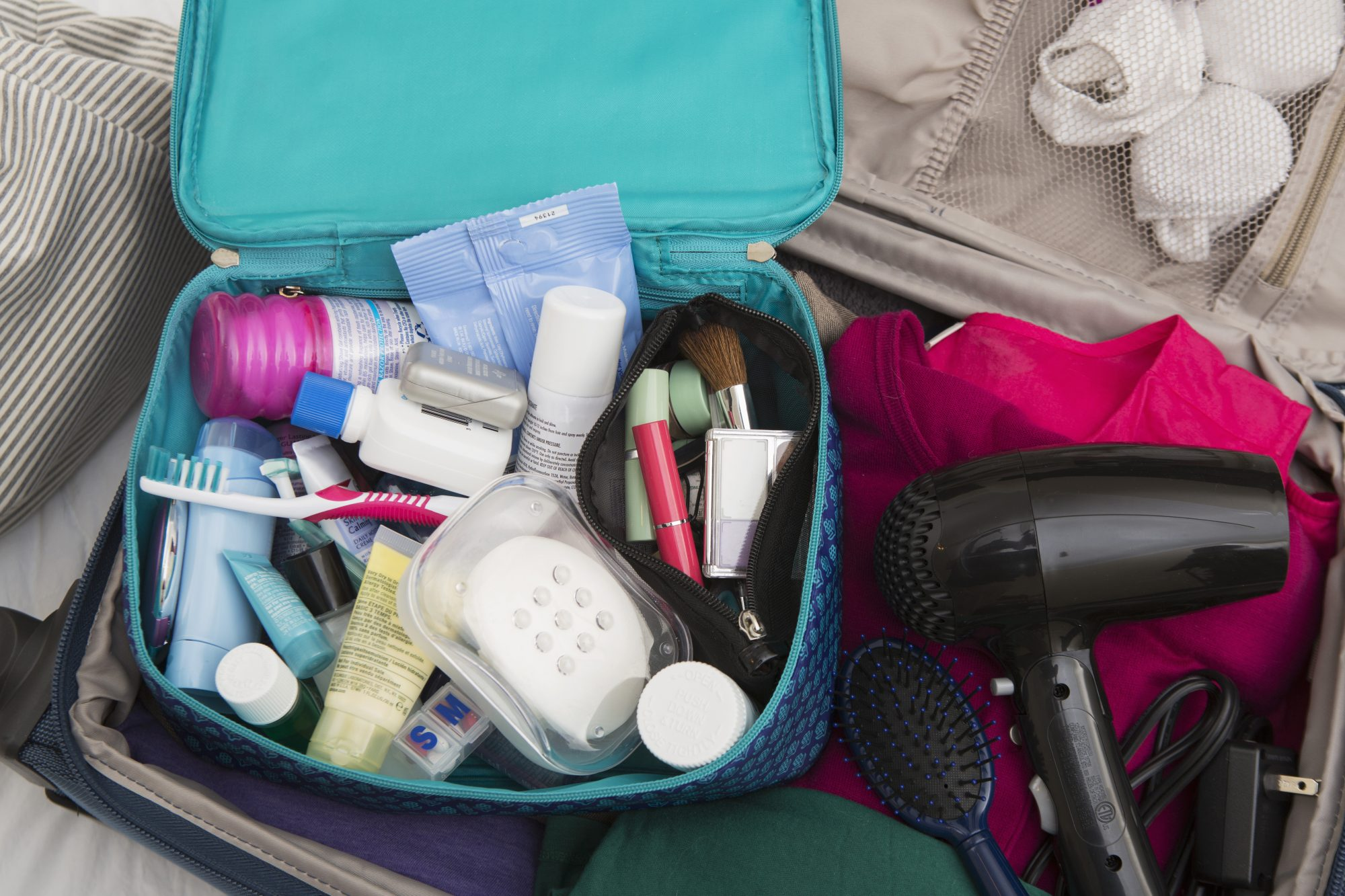 Packed Suitcase with Hair Dryer