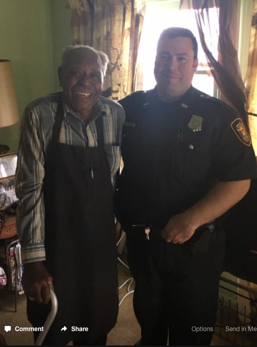 officer with ninety-five year old veteran