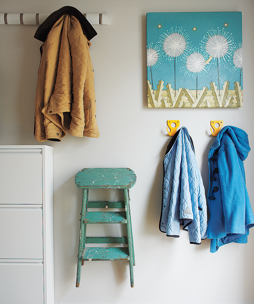 Jackets and step ladder hanging on wall