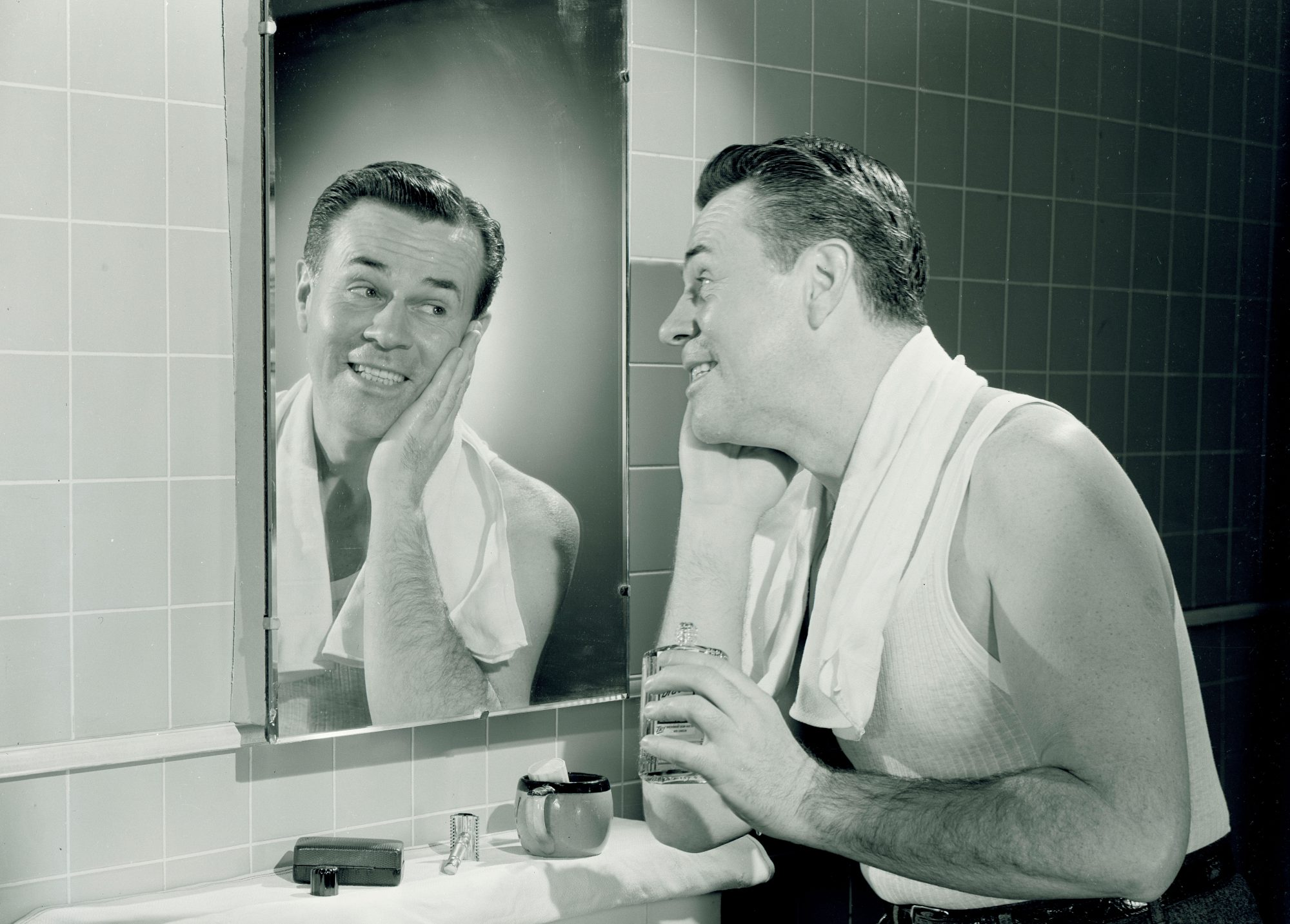 Man Putting on Aftershave