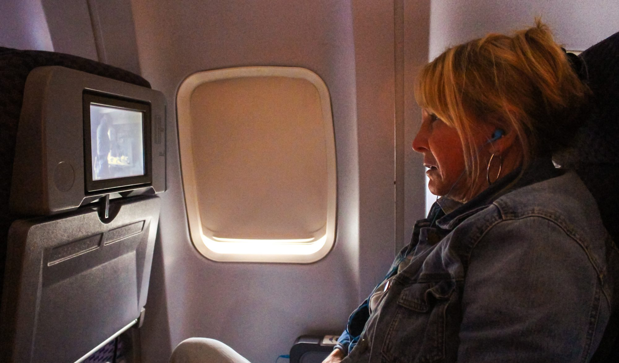 Woman Watching Movie on Airplane
