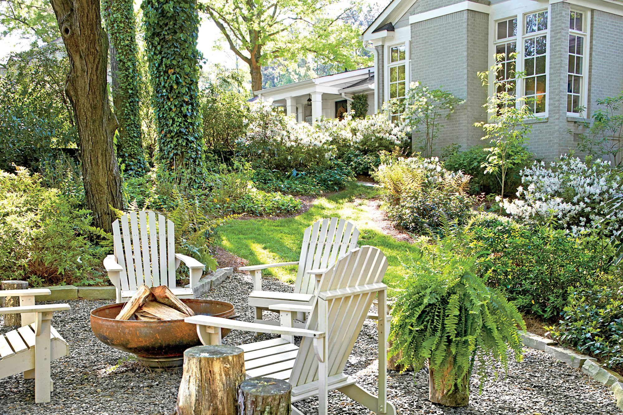 Adirondack Chairs, Gravel Surface, and Fire Pit Backyard