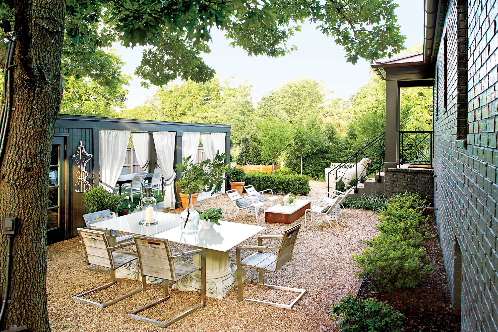 Gravel Courtyard with Seating and Dining Space