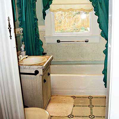 outdated bathroom with a window in the shower stall, yellow tile on the floor and a green shower curtain