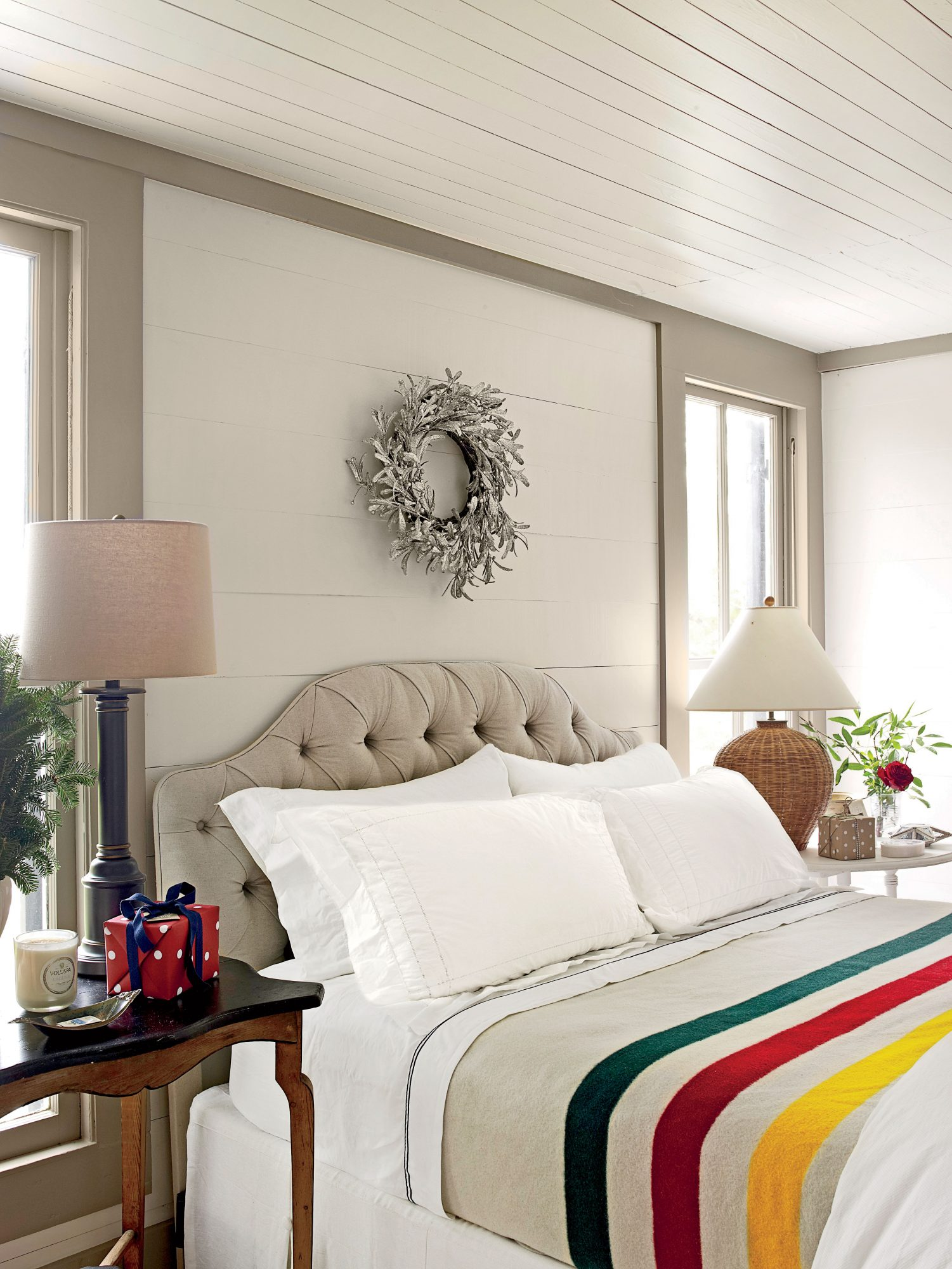 Bedroom with Shiplap Ceiling and Bright Comforter