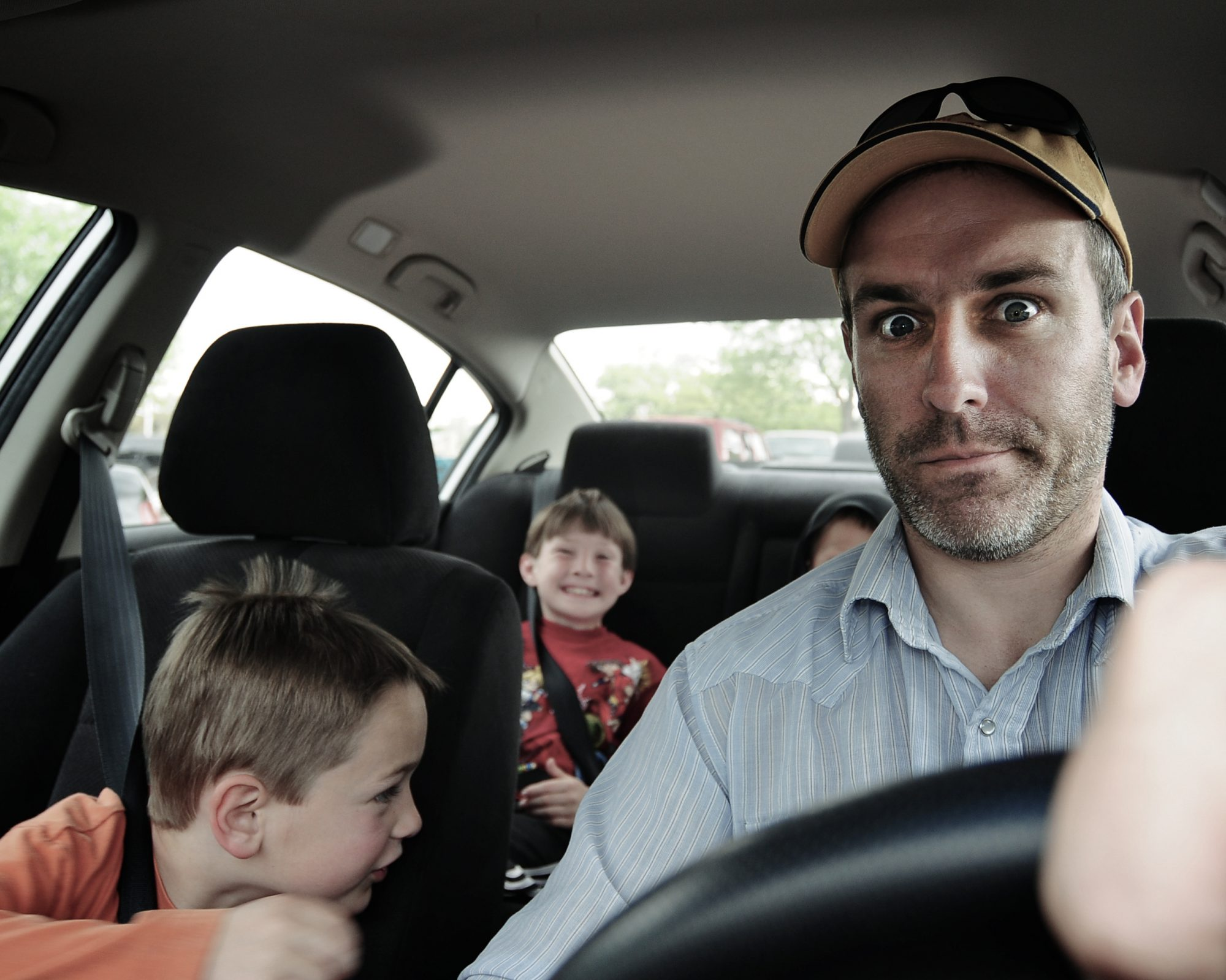 Dad in Car with kids