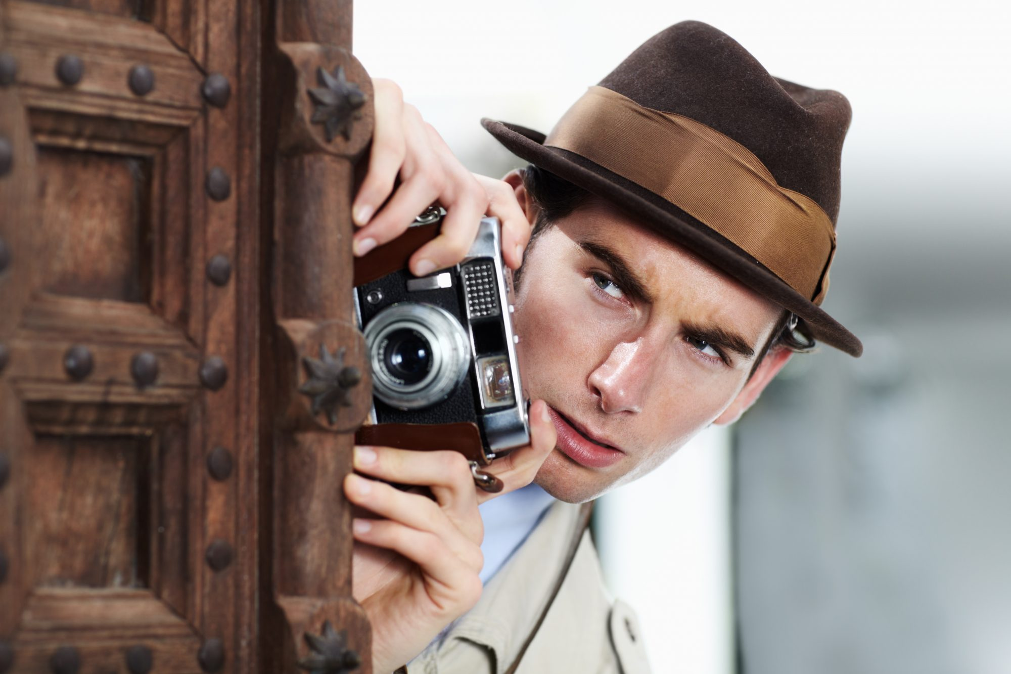 Man taking picture with vintage camera