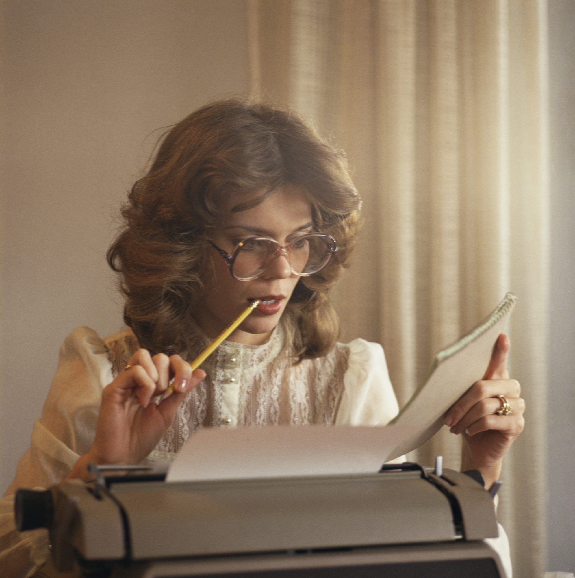 Woman working with typewriter