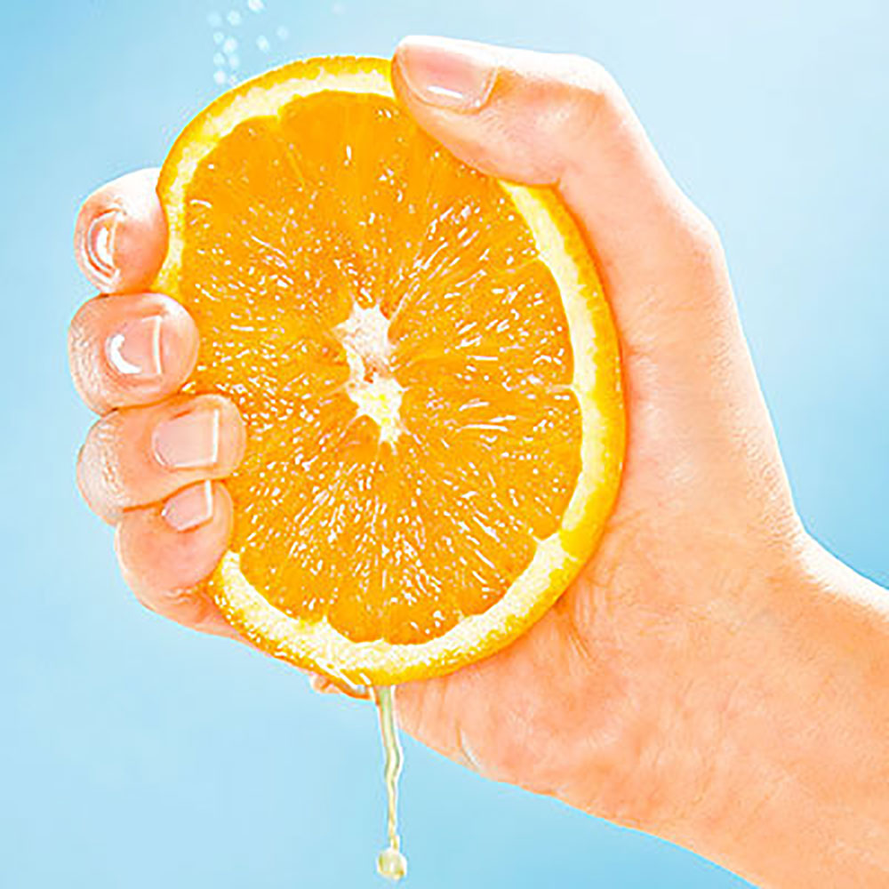 Person Squeezing Orange