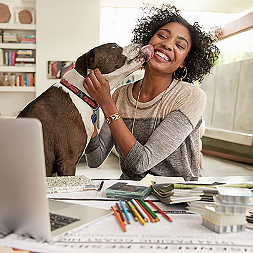 Woman Paying with Dog