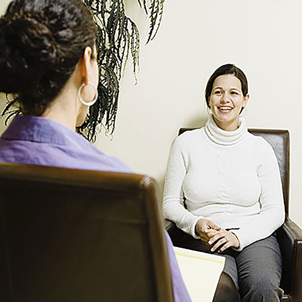 Woman Smiling at Therapist