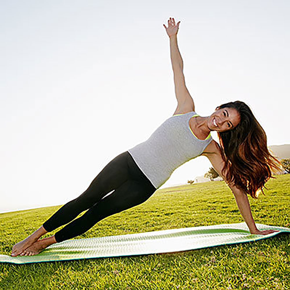 Woman Smiling in Yoga Pose