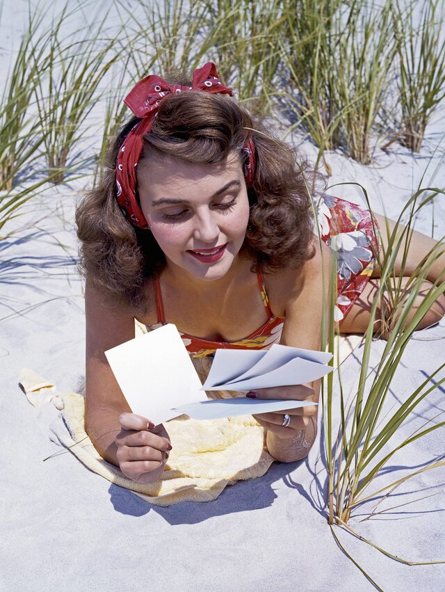 Woman Reading Love Letters on Beach