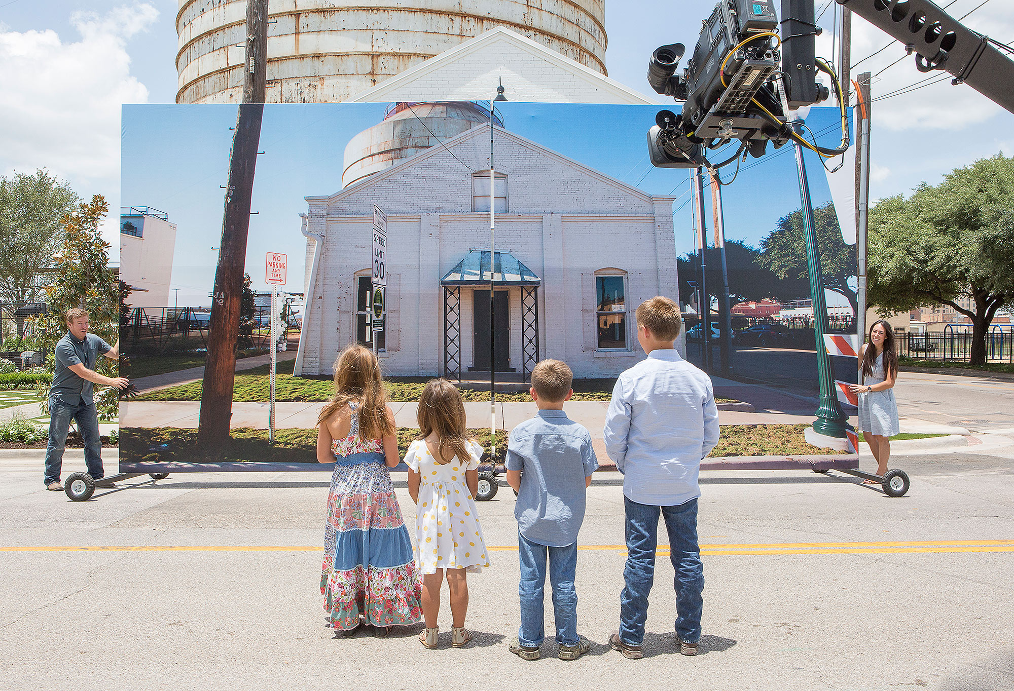 As seen on FIxer Upper, the Gaines children prepare to see the Balkery reveal. (Behind-the-scenes)