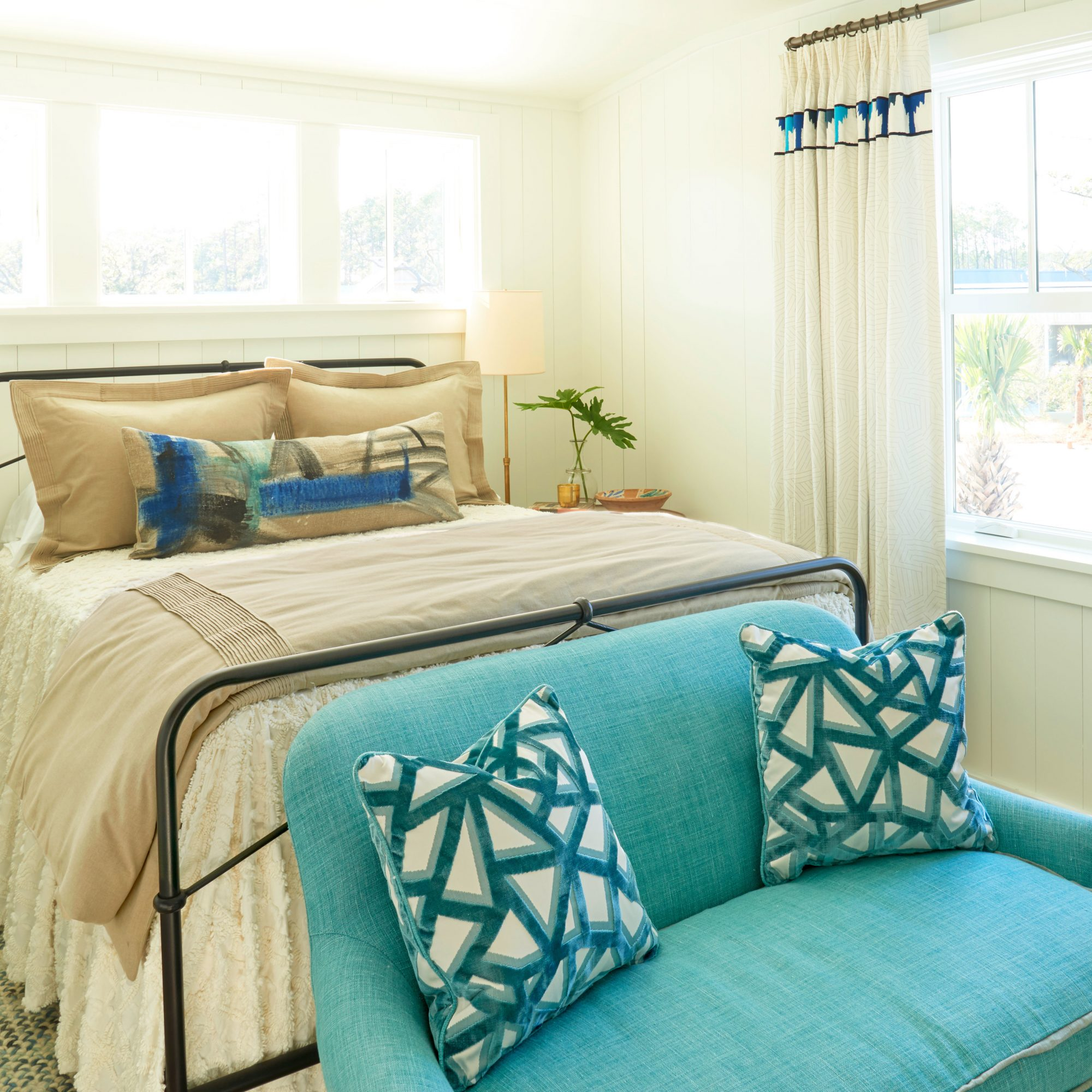 A cozy teal and white bedroom in a Lowcountry house.