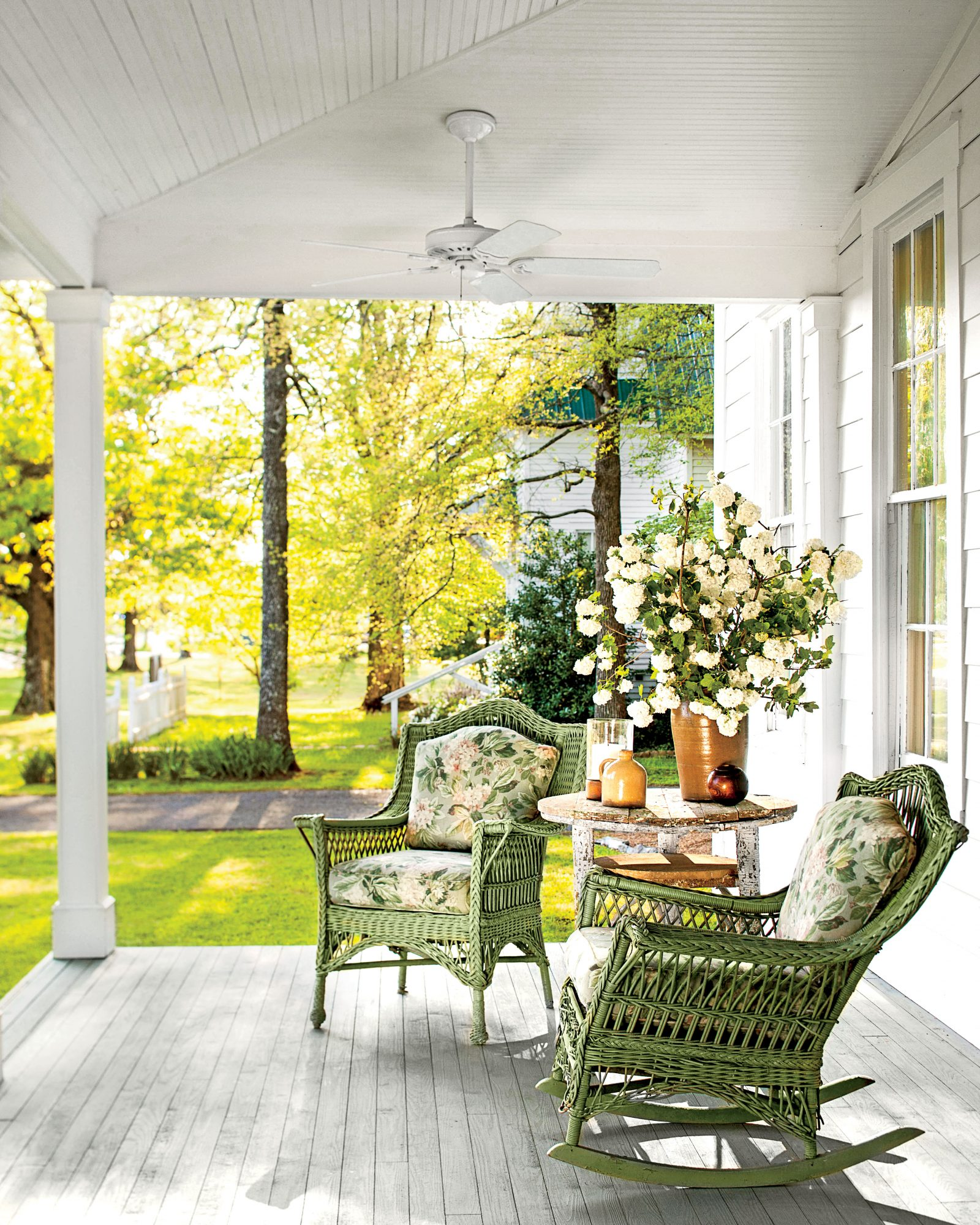 White Porch with Green Wicker Rocking Chairs
