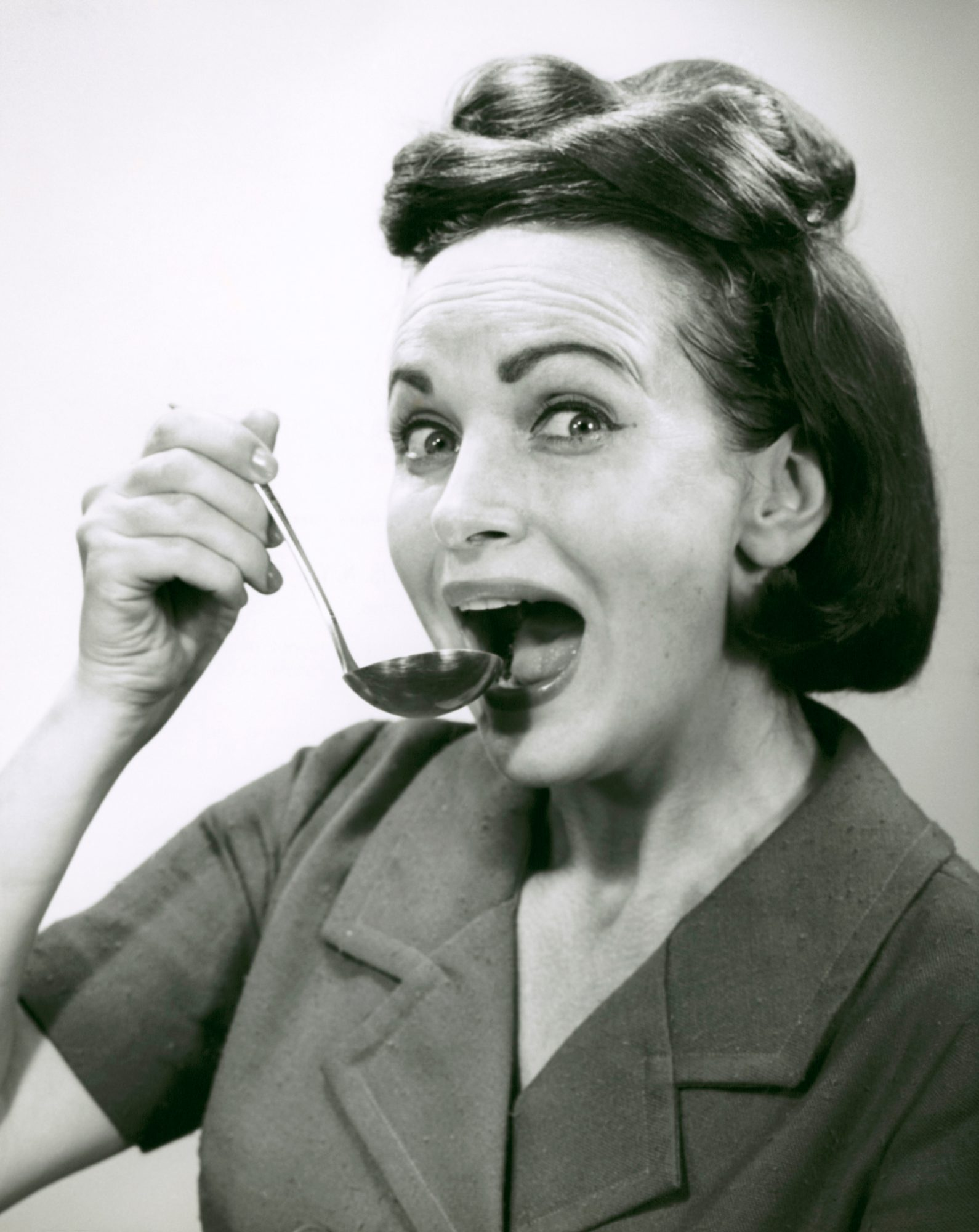 Woman Eating With Soup Ladle
