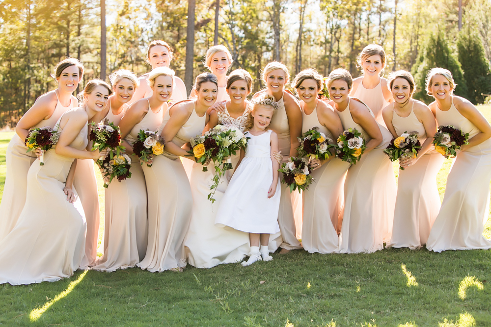 Big Bridal Party Wearing Neutral Dresses