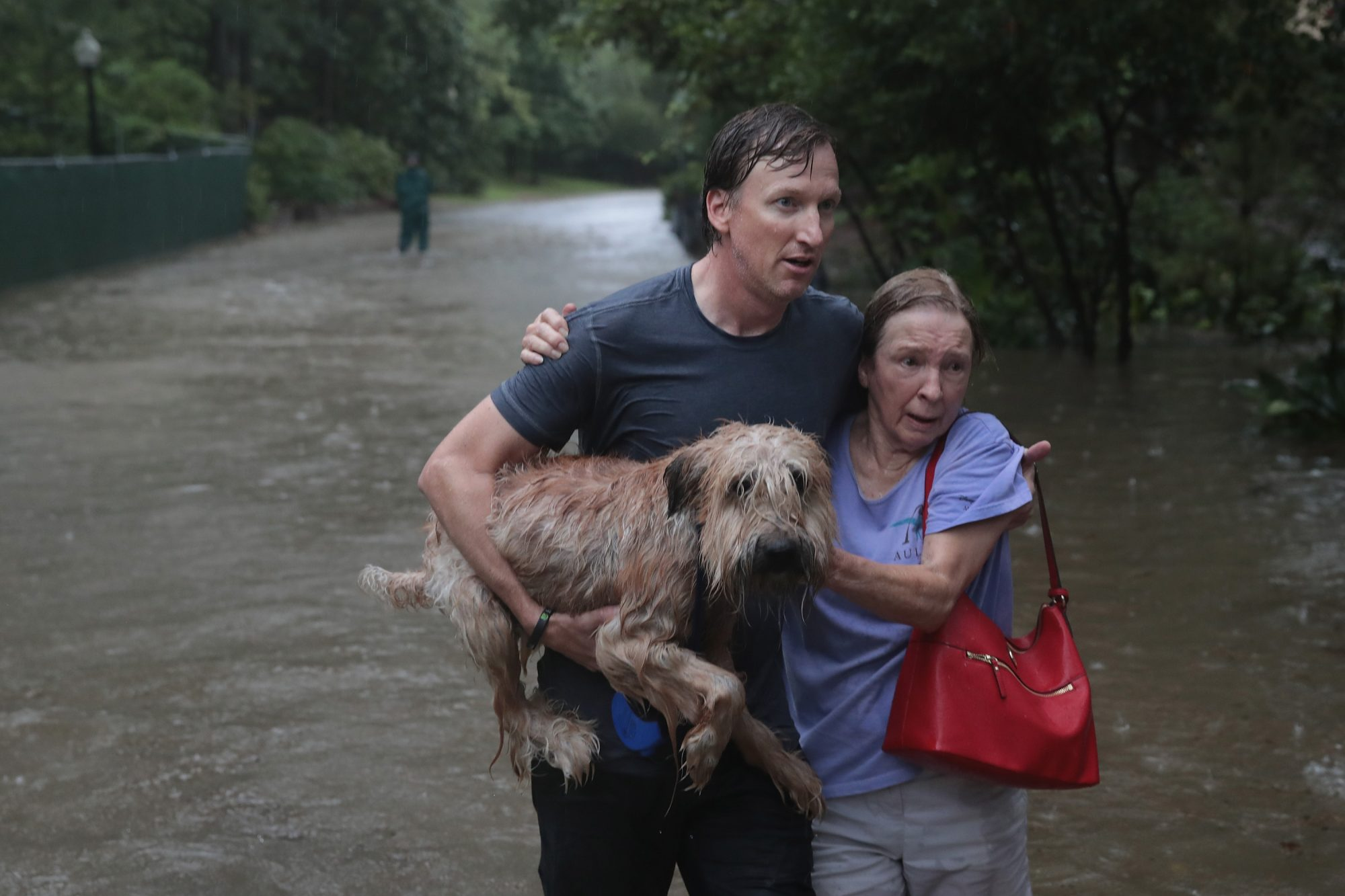 man rescues neighbor and her dog in Houston flooding