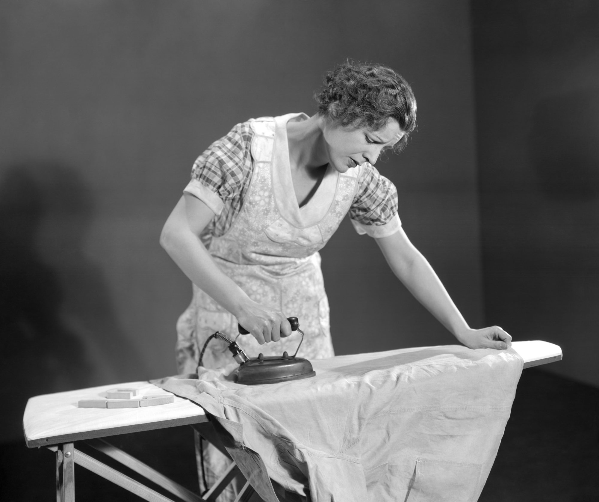 Tired Woman Ironing