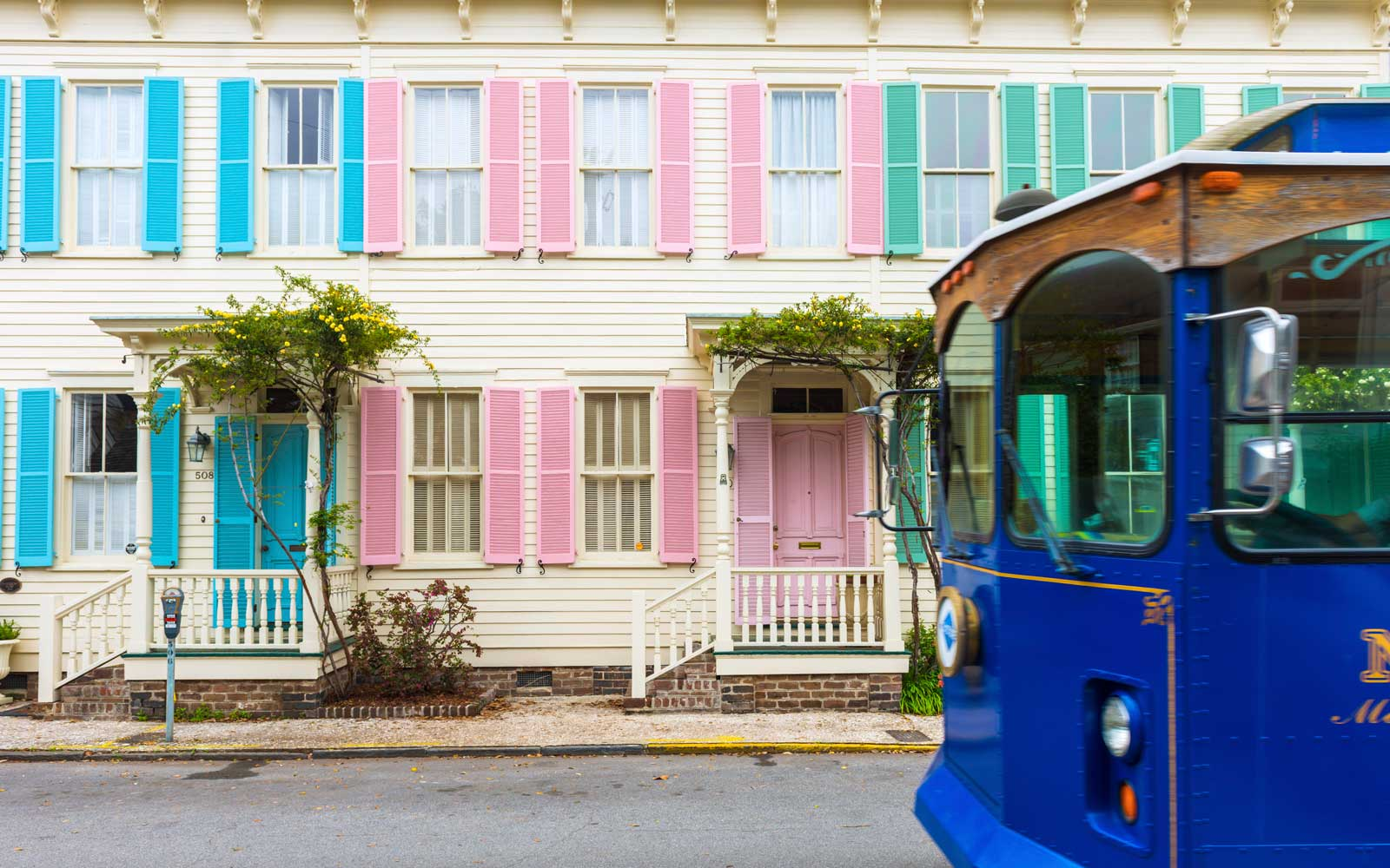 Savannah Trolley past a row of colourful houses