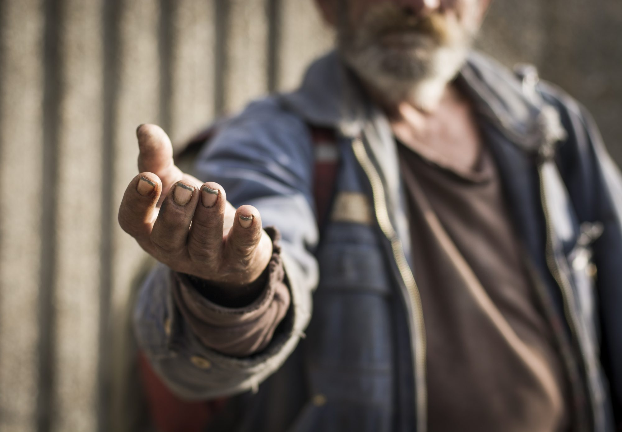 homeless man with hand out