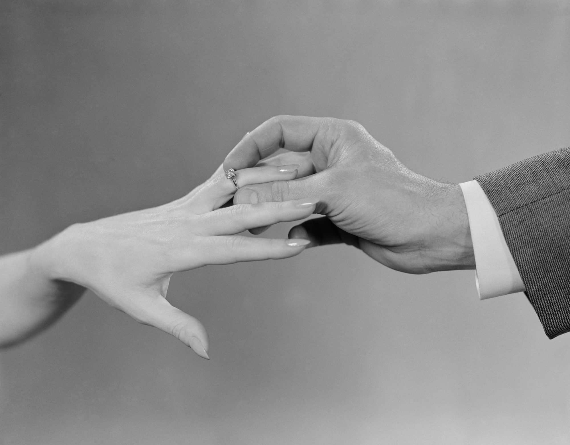 Man Placing Ring on Finger