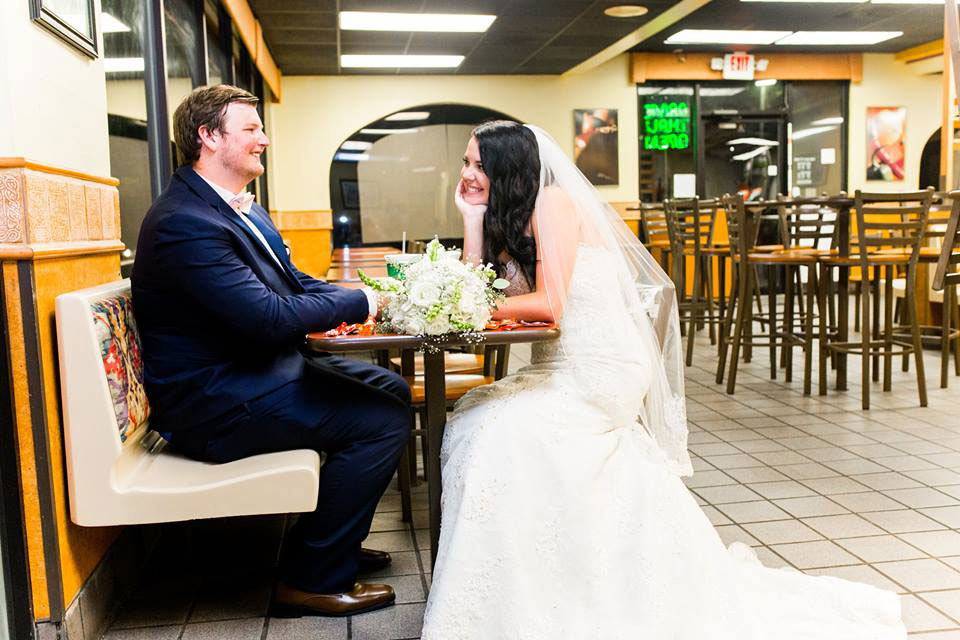 Couple Sitting in Taco Bell Wedding Photo Shoot
