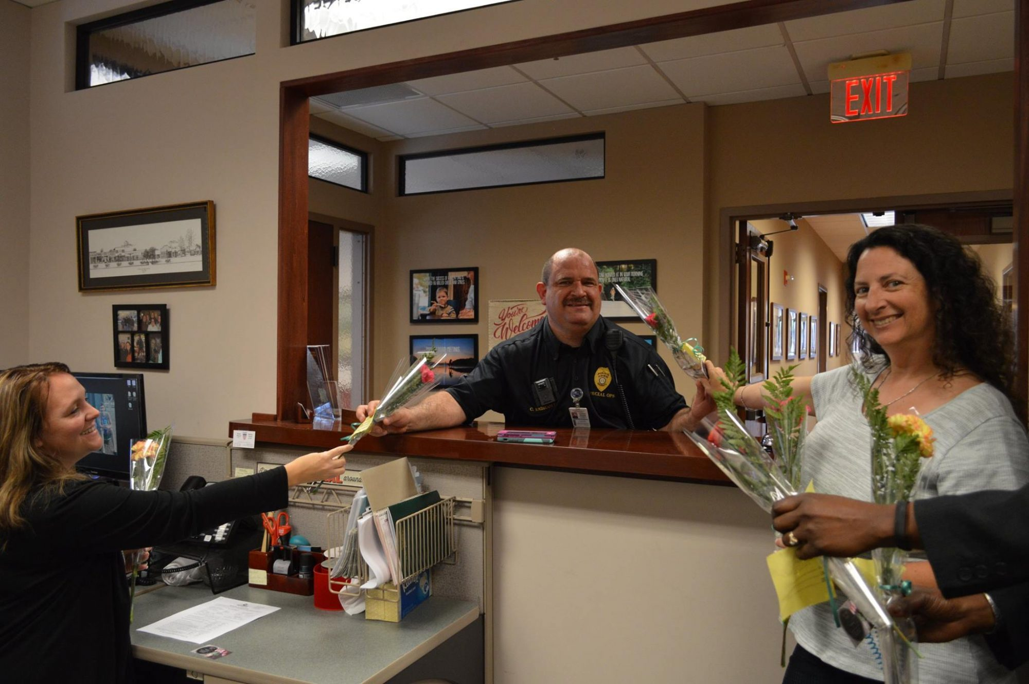 Police Officer Handing Out Flowers