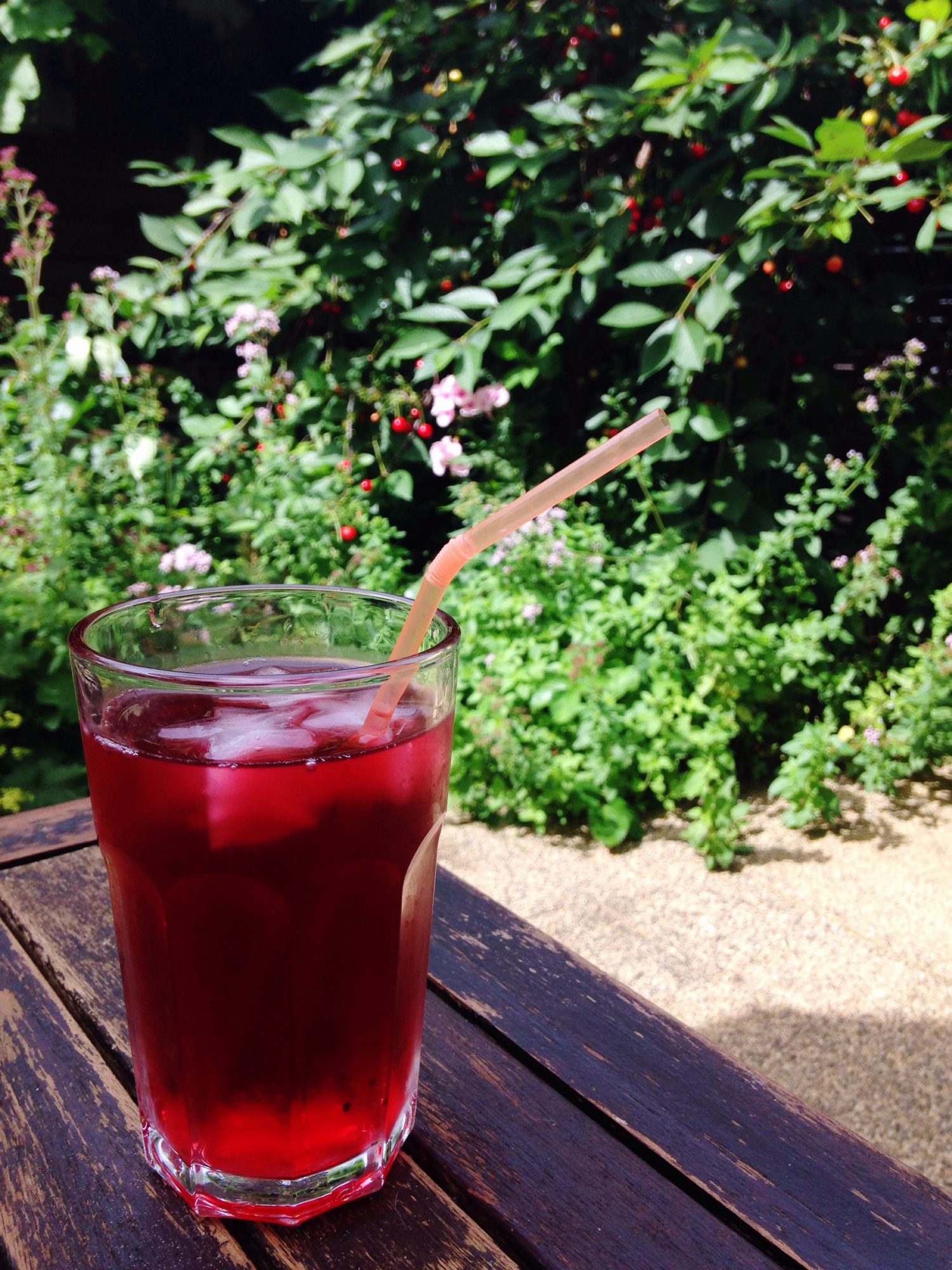 Glass of Cherry Juice and a Bendy Straw