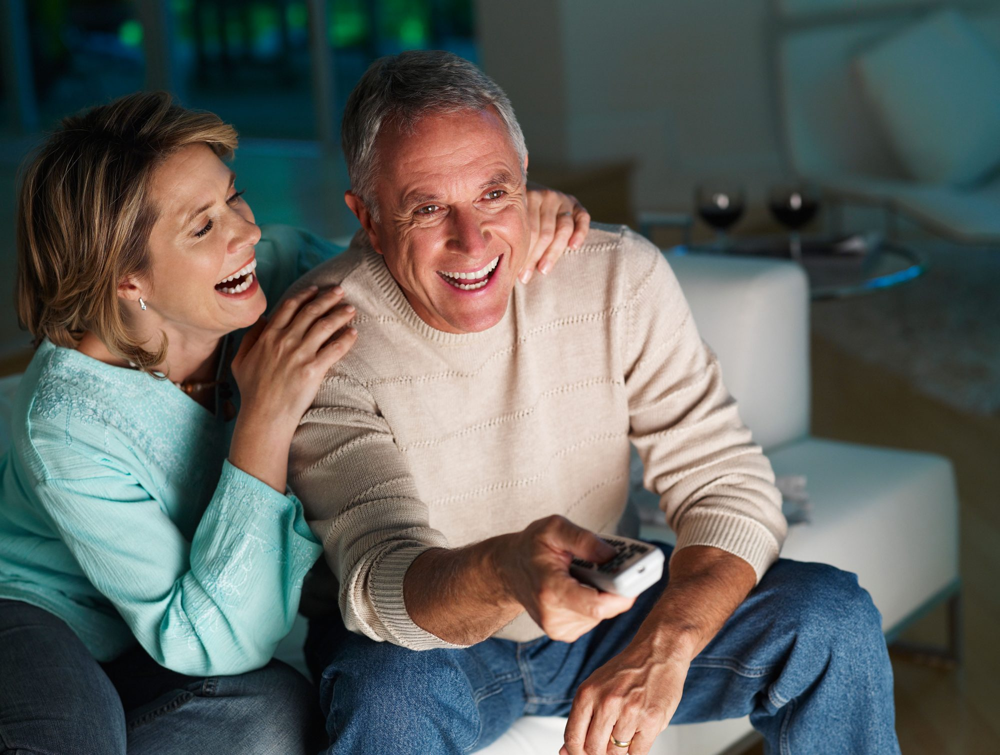 Couple Watching TV and Laughing