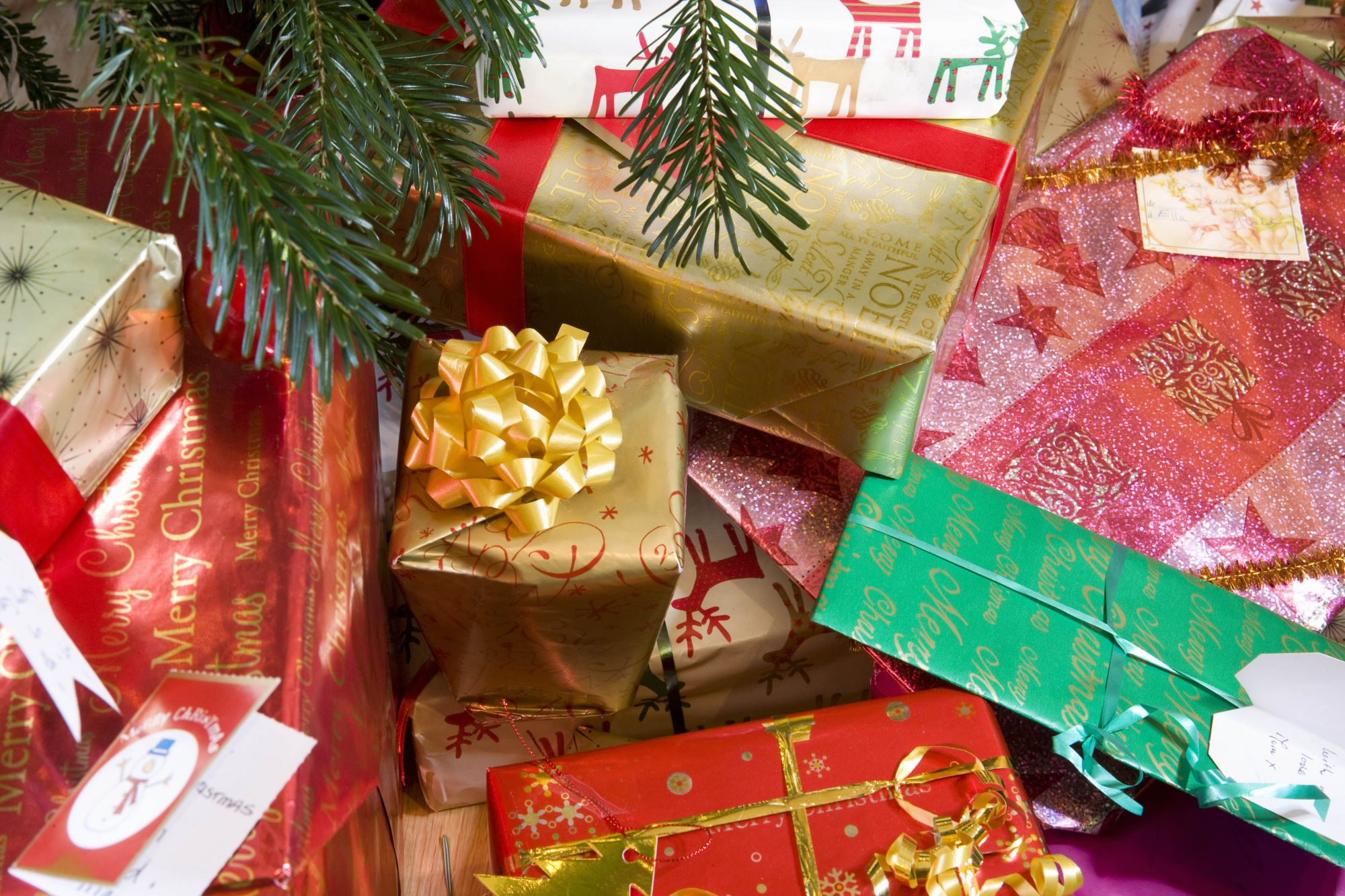 Christmas presents under decorated tree