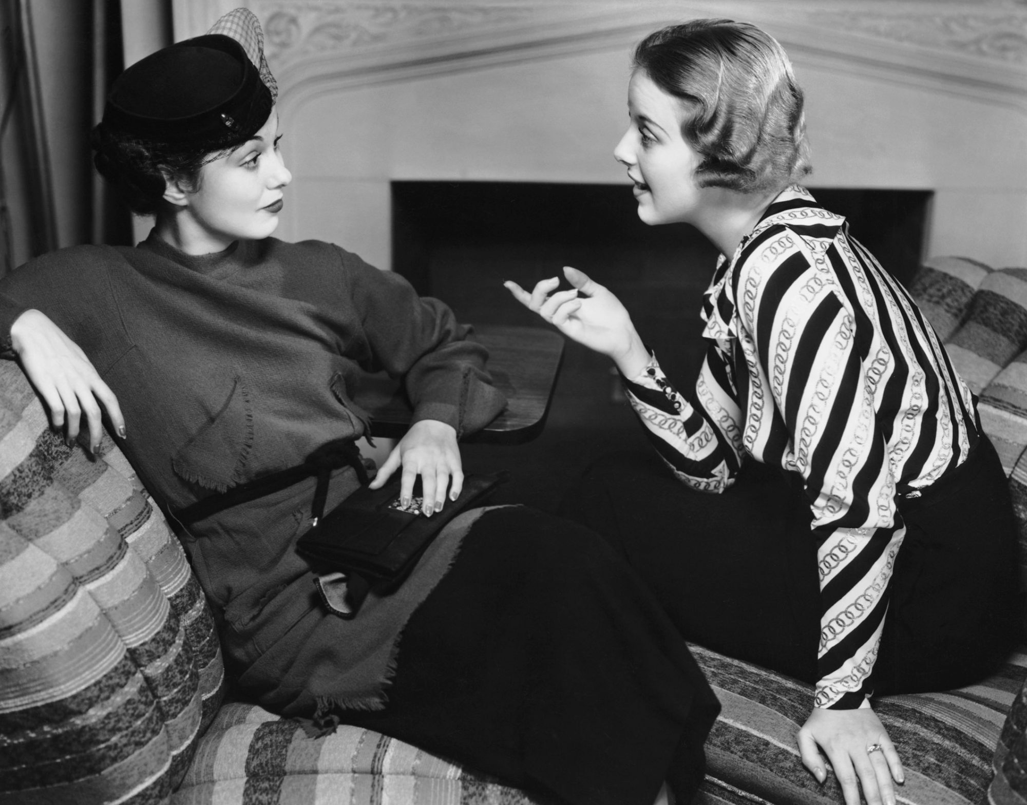 Two woman talking in old black and white photo